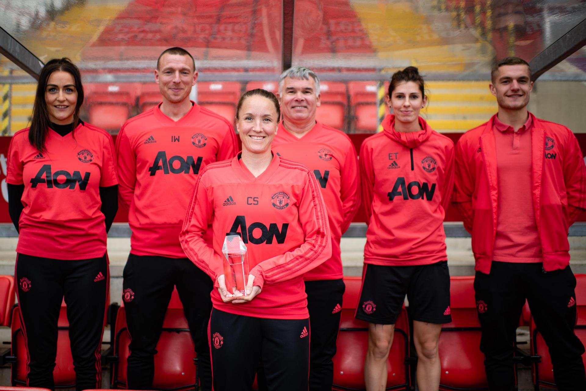 Casey Stoney and her coaching staff.