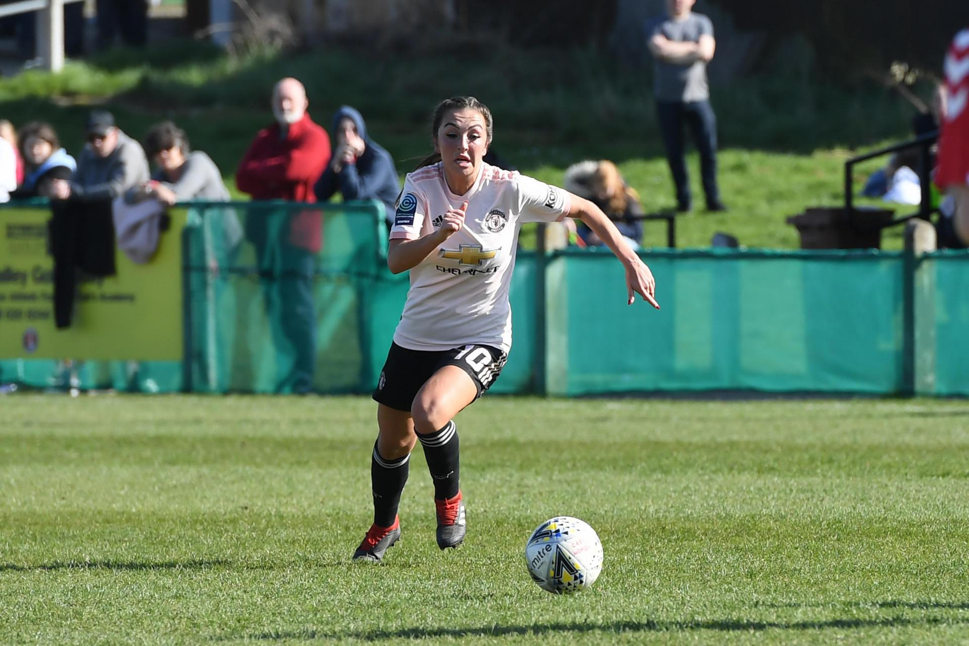 Katie Zelem stretches for the ball.