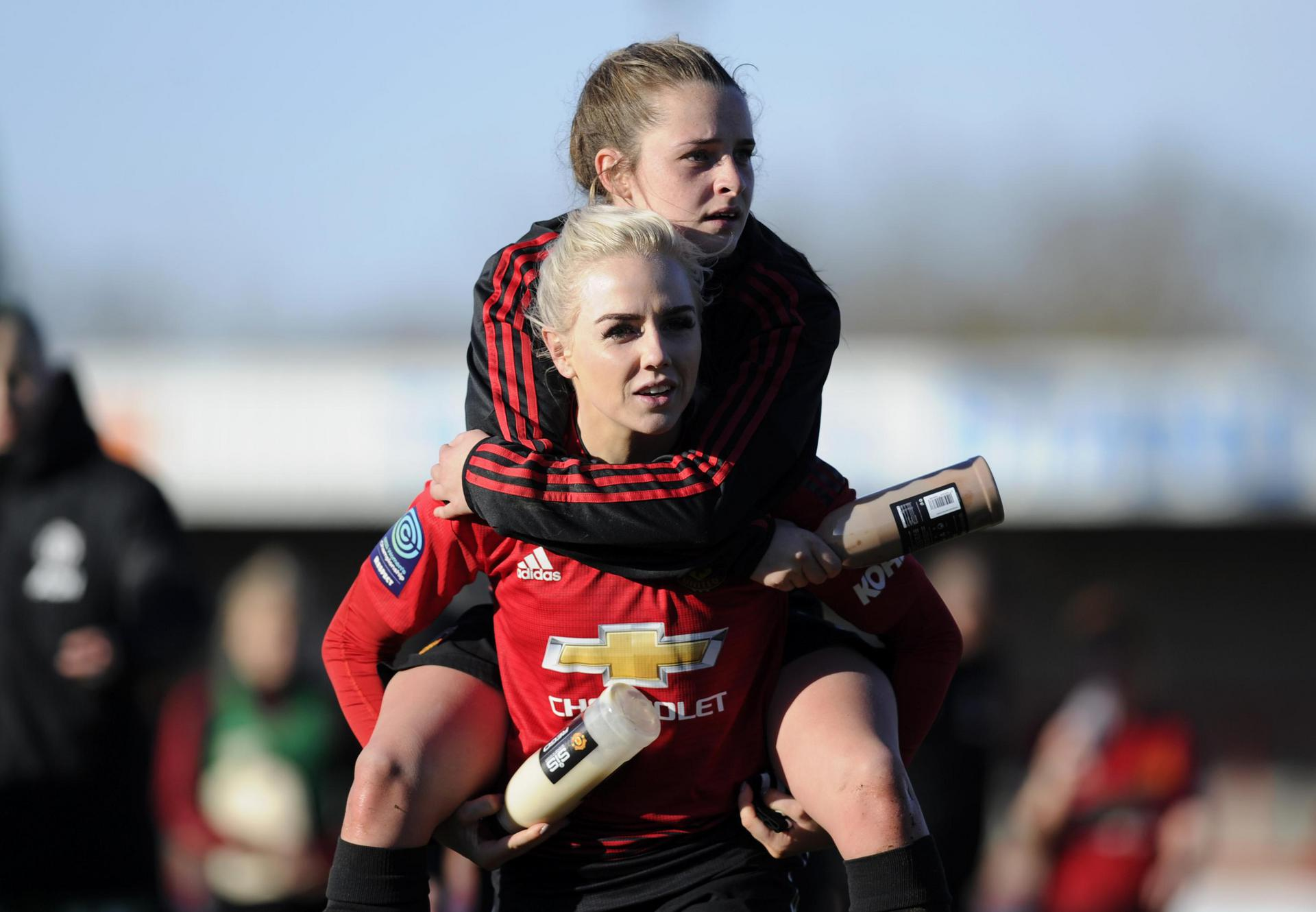 Alex Greenwood gives Ella Toone a piggyback.
