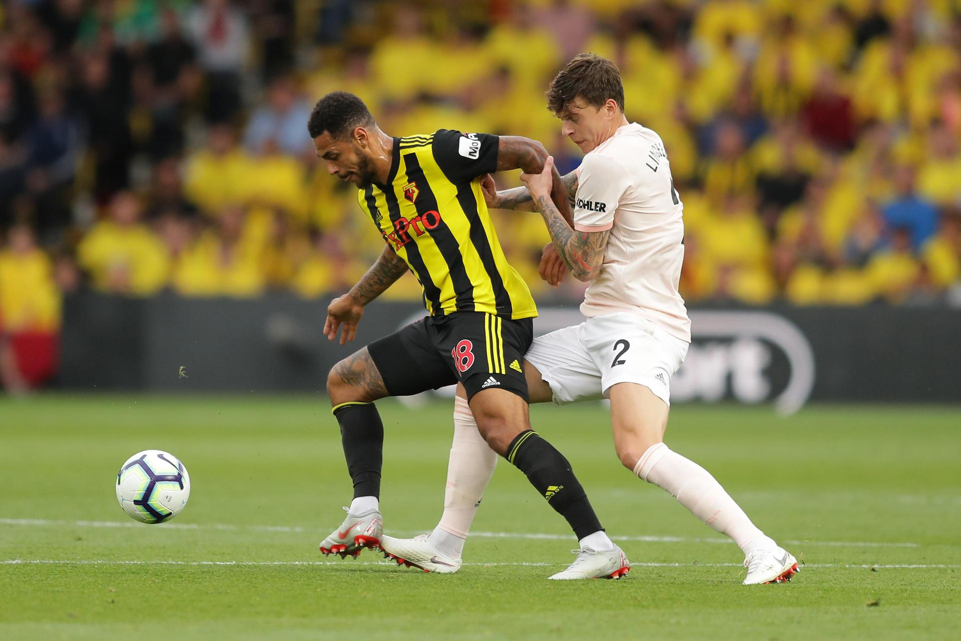 Victor Lindelof battles with Andre Gray of Watford.