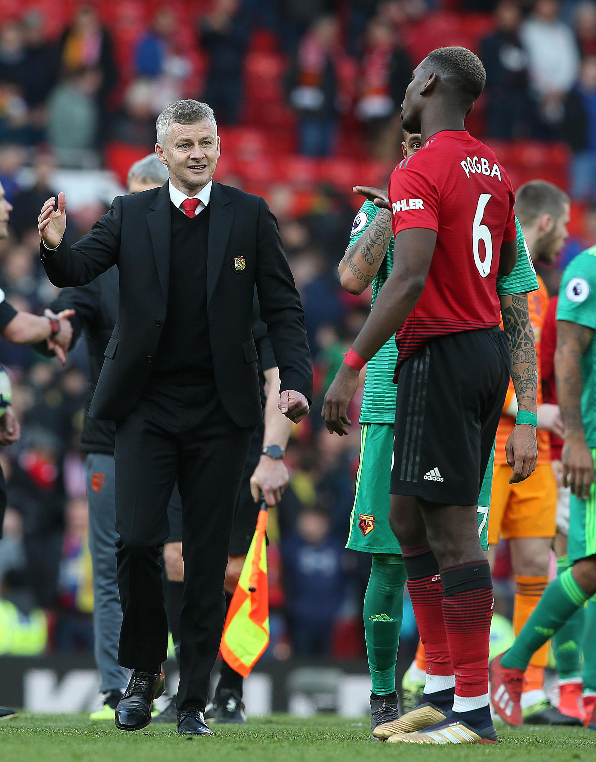 Ole Gunnar Solskjaer greets Paul Pogba at full-time in Manchester United's 2-1 win over Watford