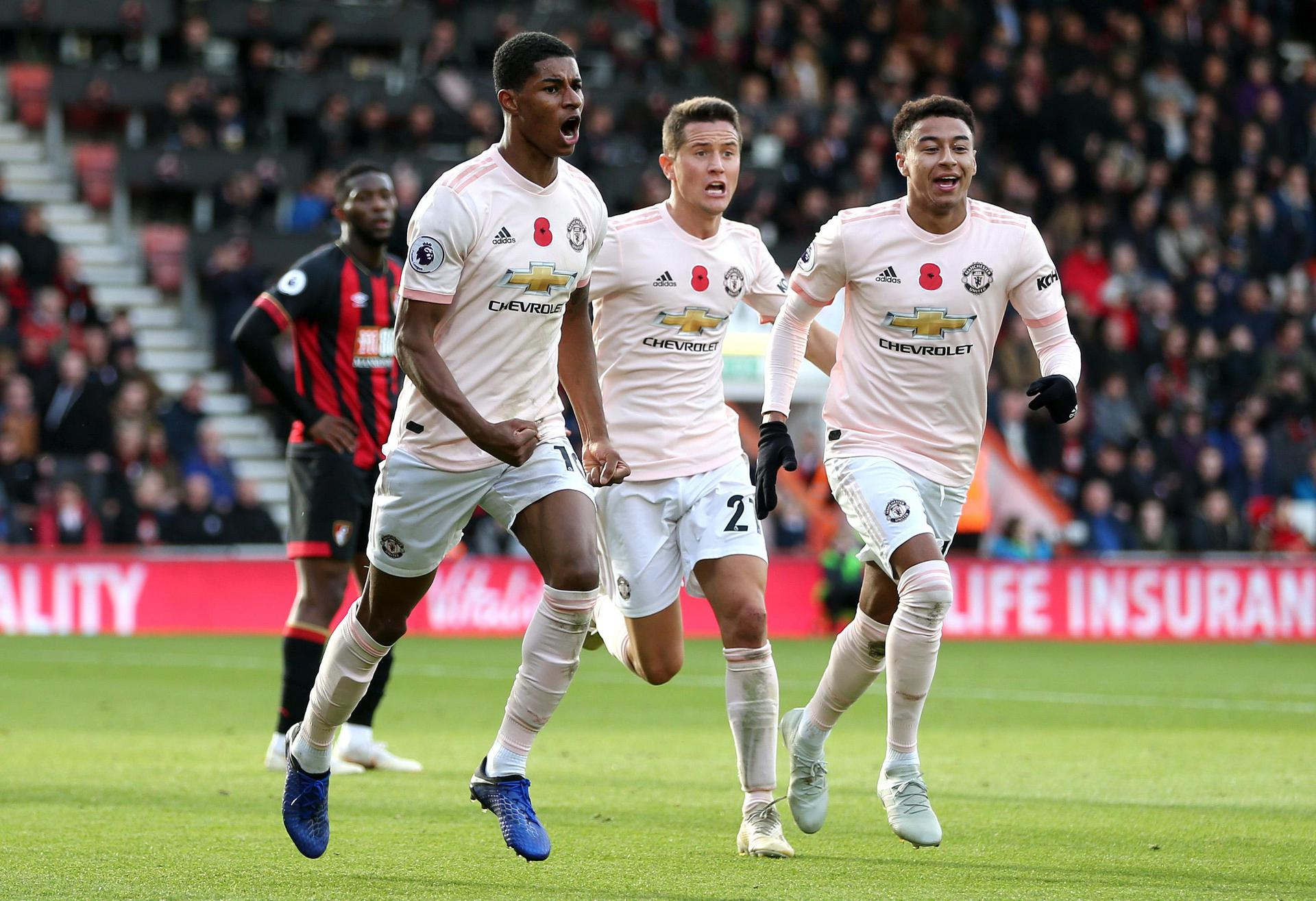 Marcus Rashford celebrates his winning goal at Bournemouth with Ander Herrera and Jesse Lingard