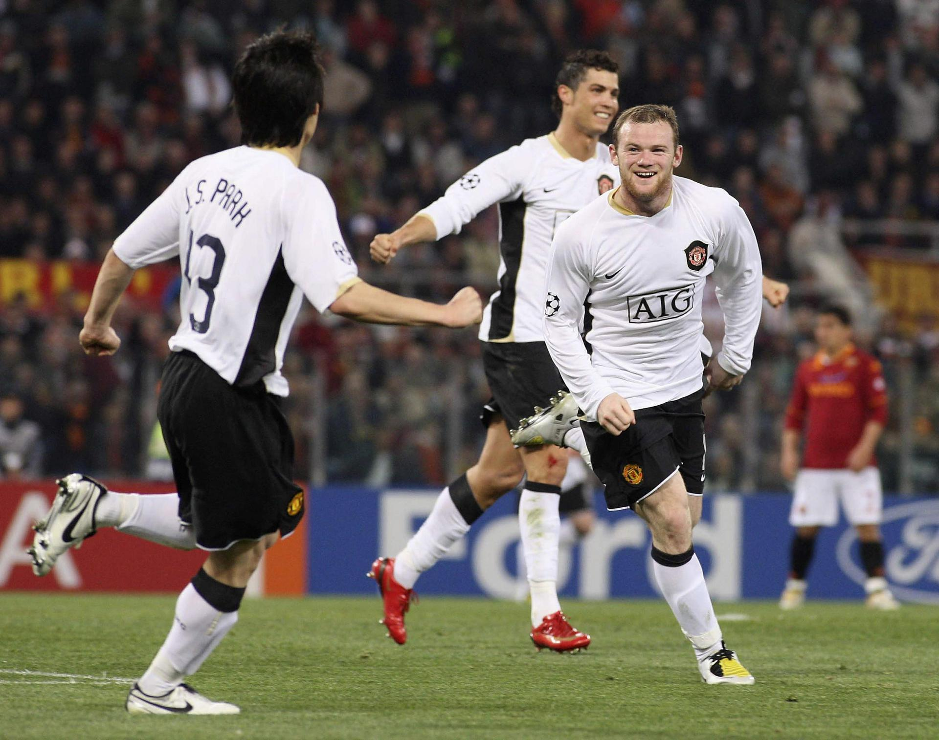 Ji-sung Park, Cristiano Ronaldo and Wayne Rooney celebrate an away goal for Manchester United against AS Roma in 2008