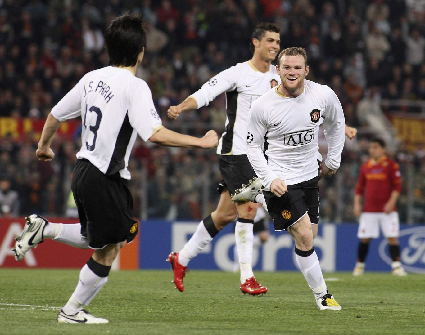 Wayne Rooney celebrates a goal against AS Roma in 2008 with Ji-sung Park and Cristiano Ronaldo.