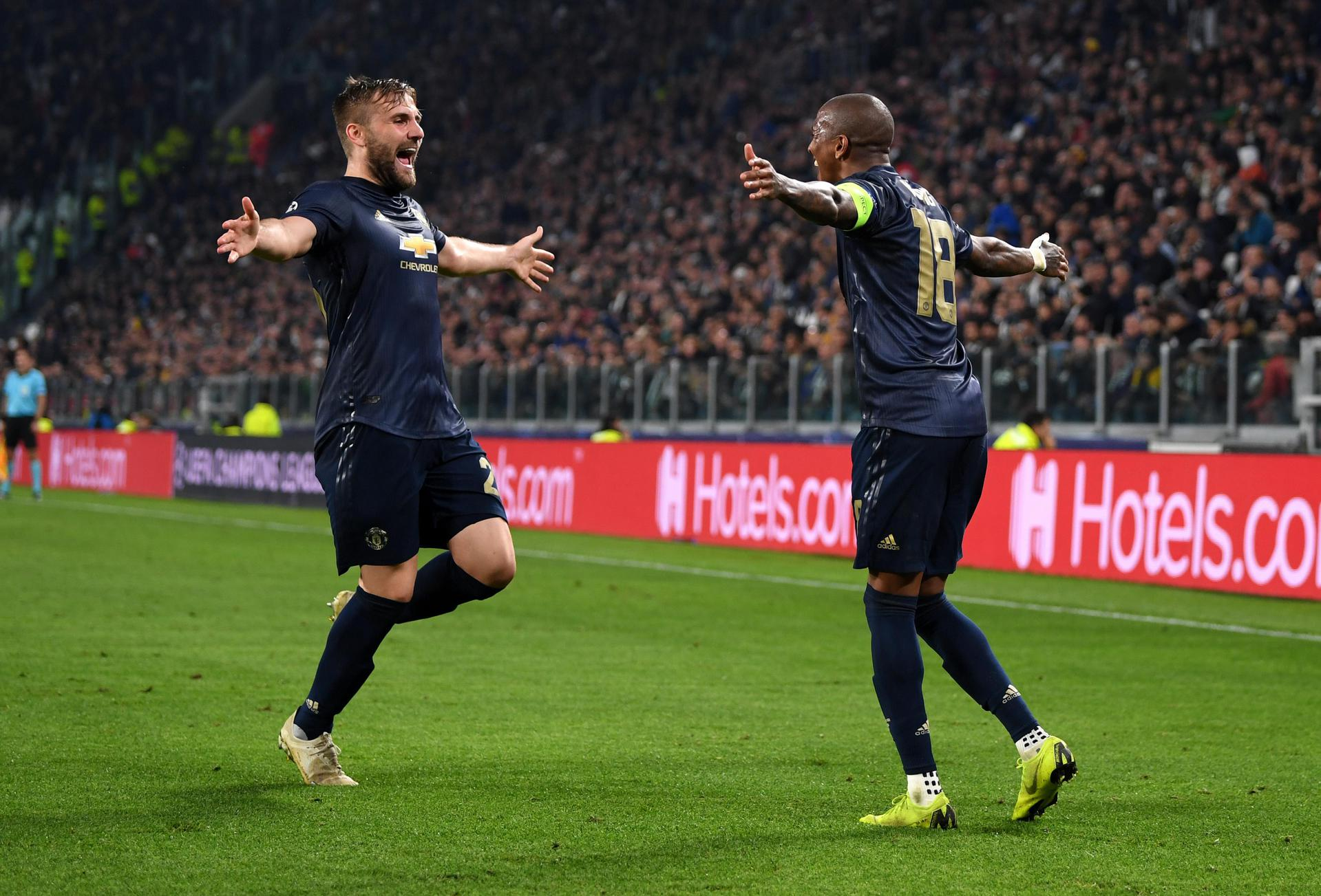 Luke Shaw and Ashley Young celebrate United's winning goal at Juventus.