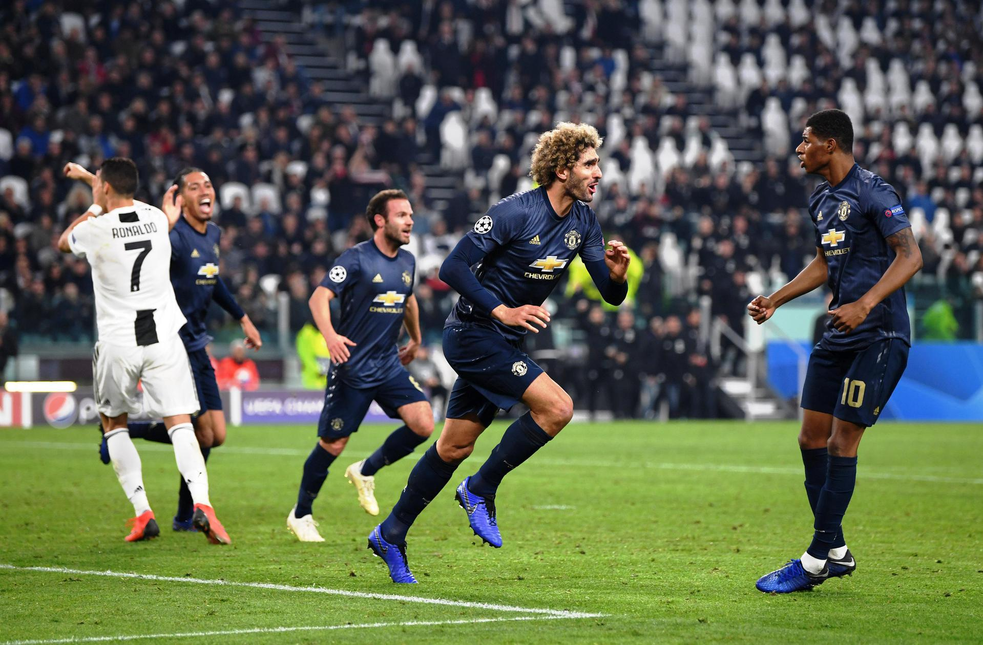 Fellaini celebrates United's winning goal against Juventus