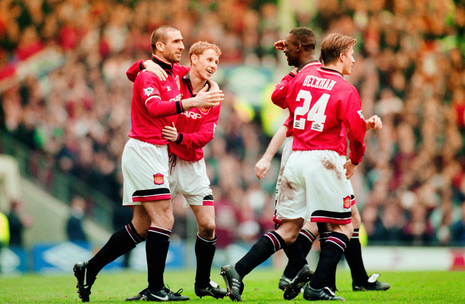 Eric Cantona celebrates with Nicky Butt, Andy Cole and David Beckham