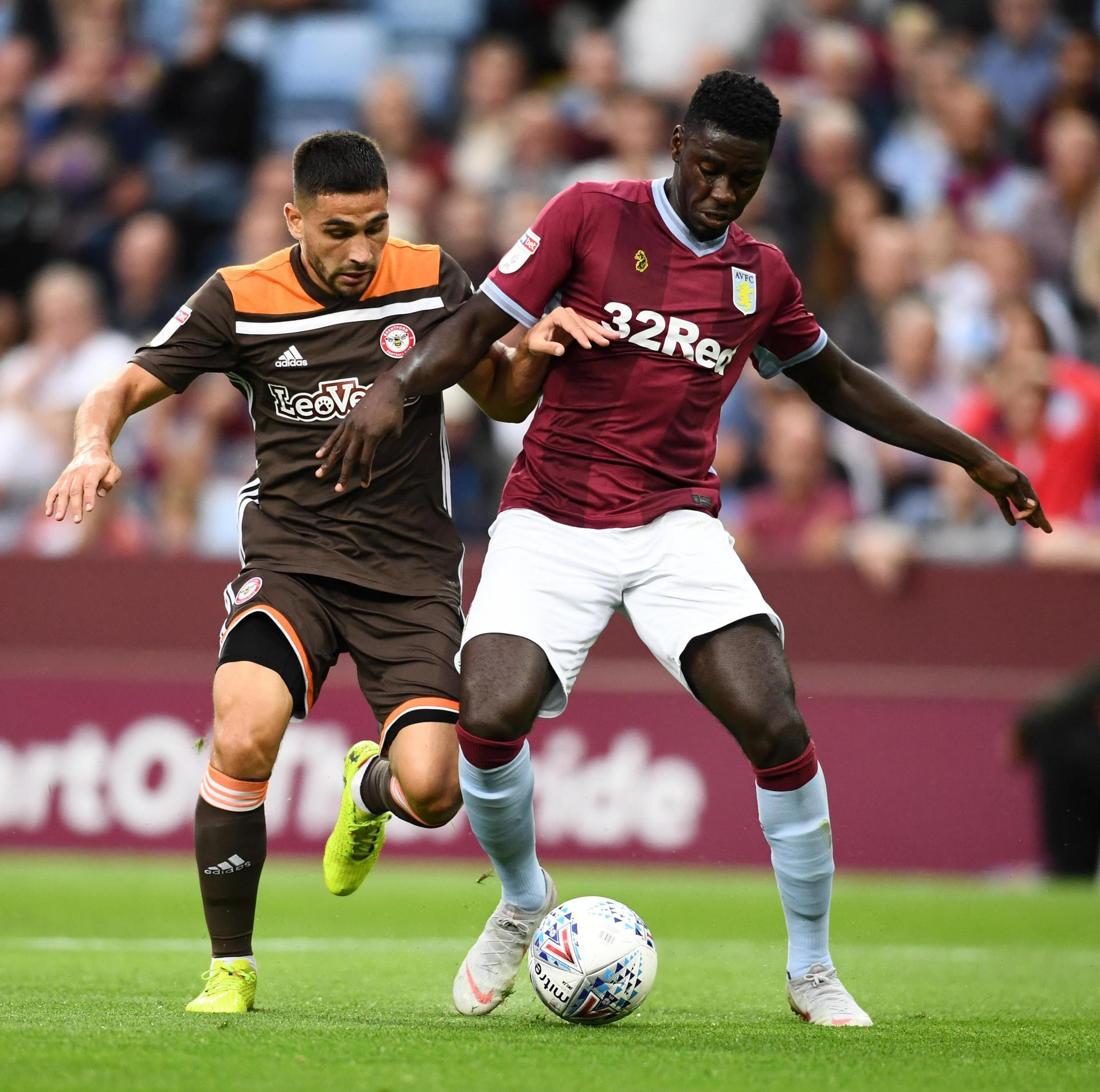 Axel Tuanzebe takes on Neil Maupay of Brentford.