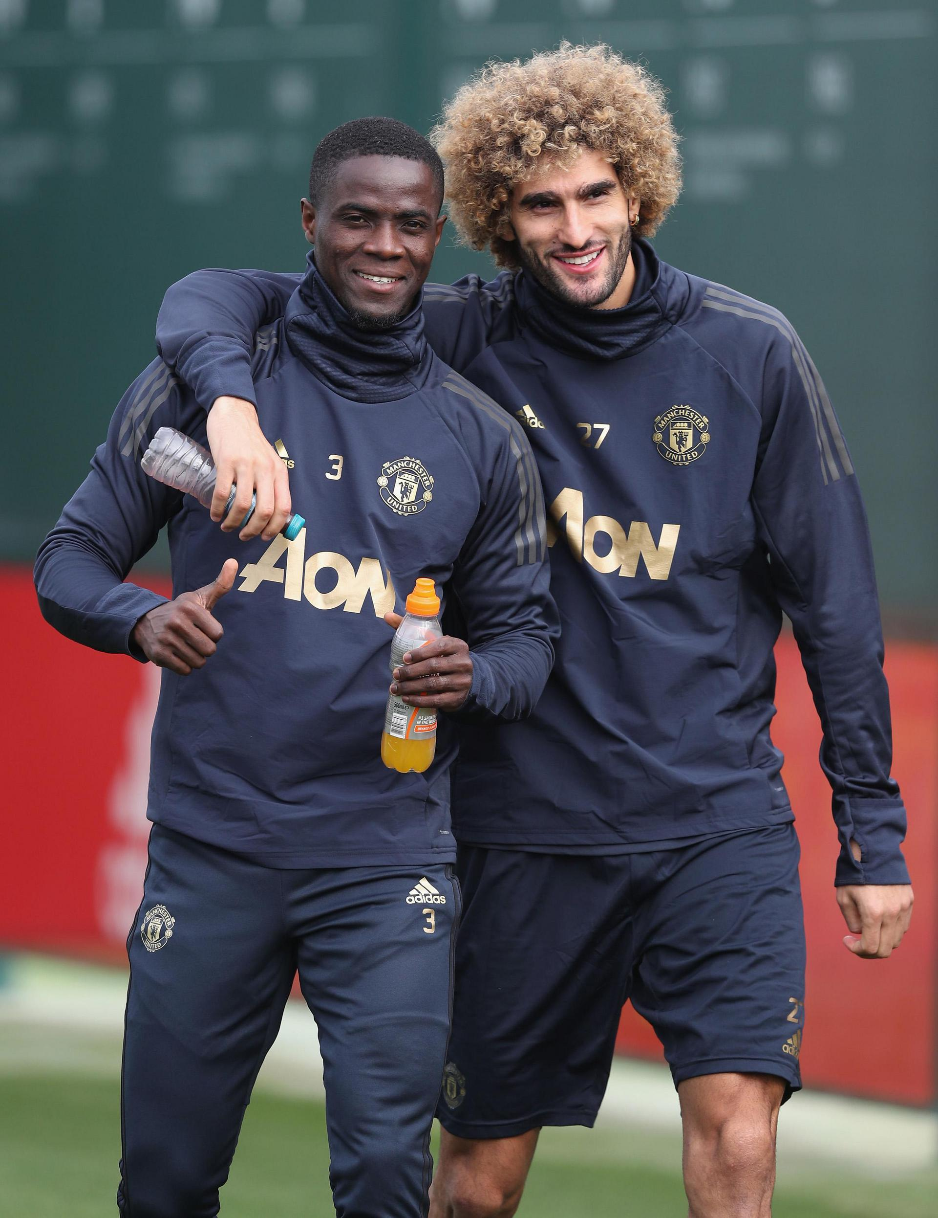 Eric Bailly and Marouane Fellaini during a Manchester United training session.