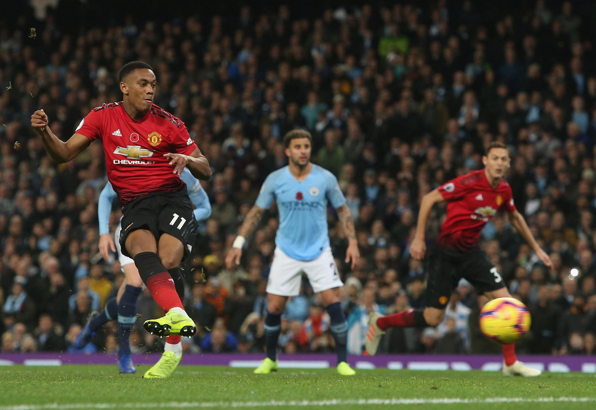 Anthony Martial strokes in the penalty against Manchester City.