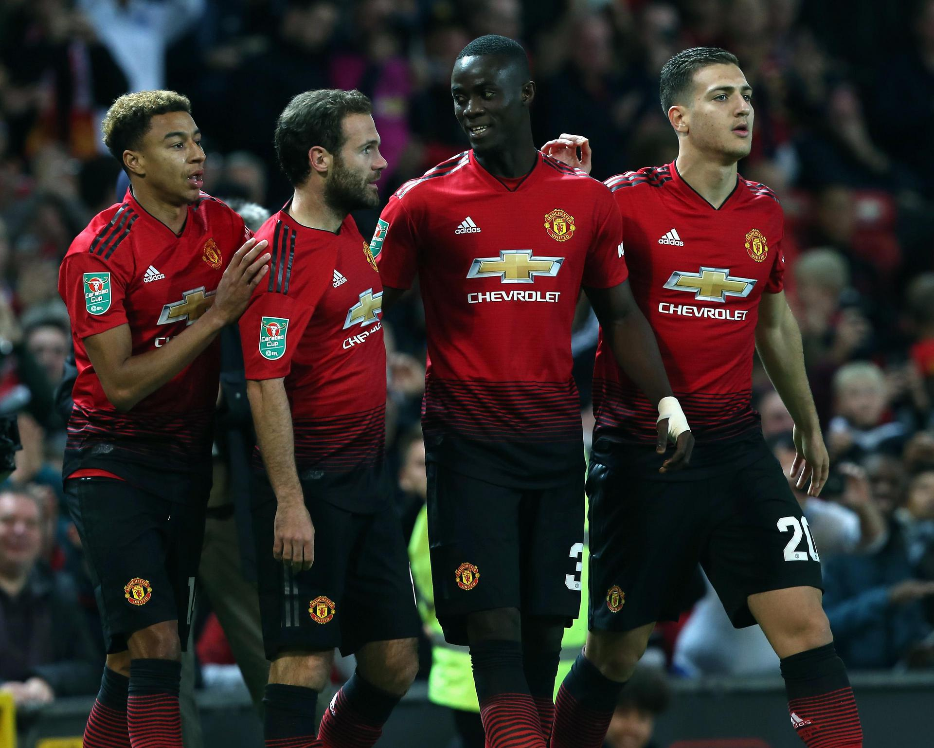 Jesse Lingard, Juan Mata, Eric Bailly and Diogo Dalot celebrate a goal against Derby County in the Carabao Cup