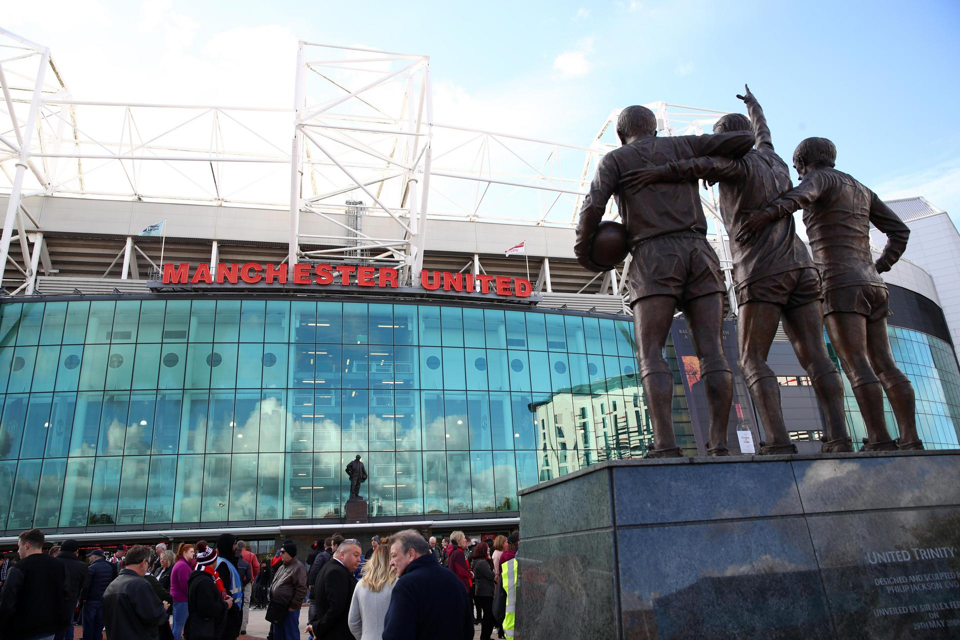 External view of the East Stand at Old Trafford, from behind the Best-Law-Charlton statue.
