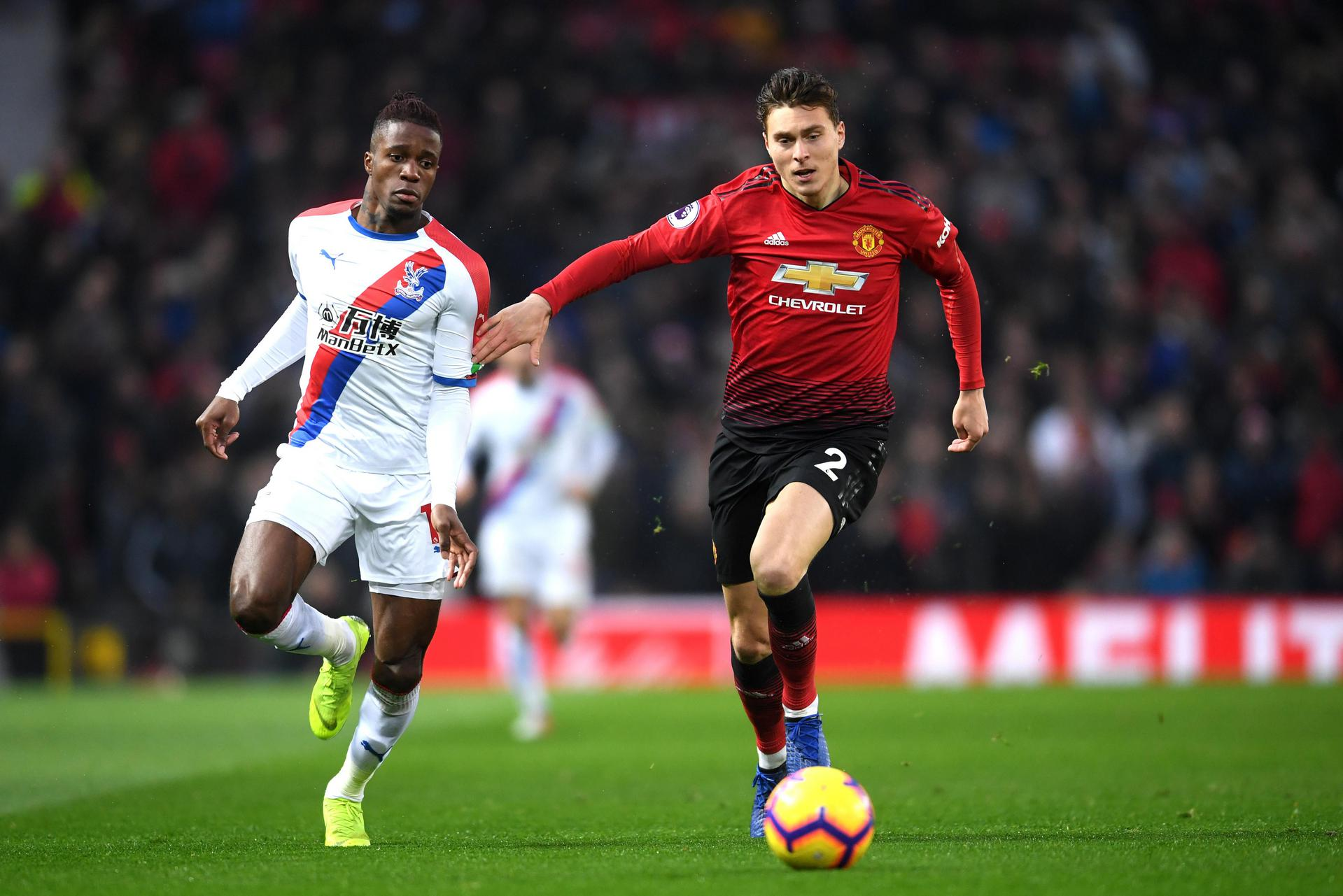 Wilfried Zaha and Victor Lindelof compete for the ball during United's Premier League game with Crystal Palace in November 2018.