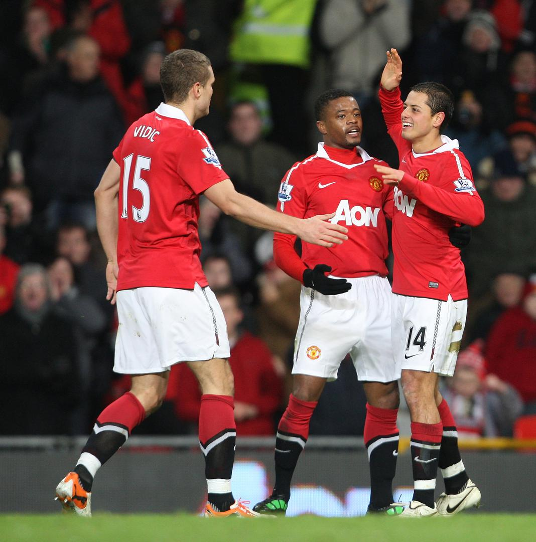 Nemanja Vidic, Patrice Evra and Javier Hernandez celebrate a goal for Manchester United at Old Trafford