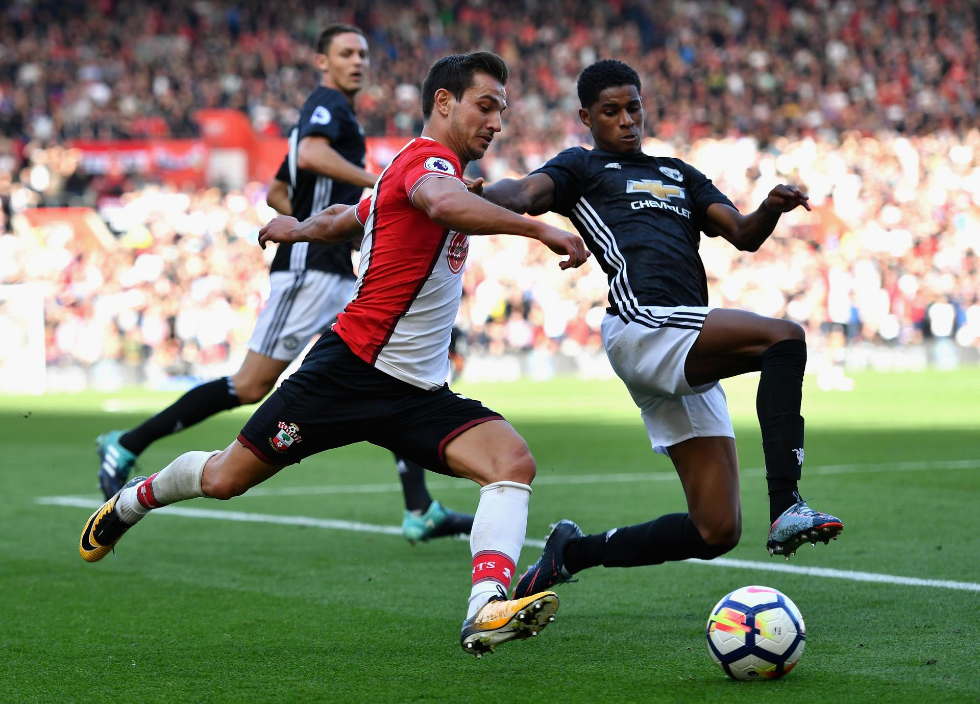 Cedric Soares tries to cross the ball as Marcus Rashford closes in