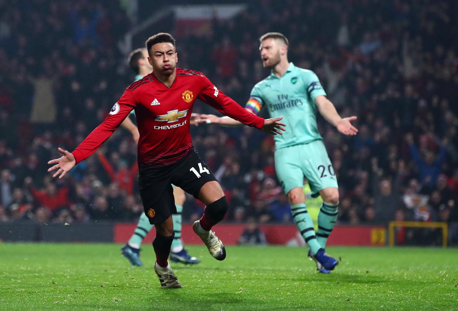 Jesse Lingard celebrates after making it 2-2 against Arsenal