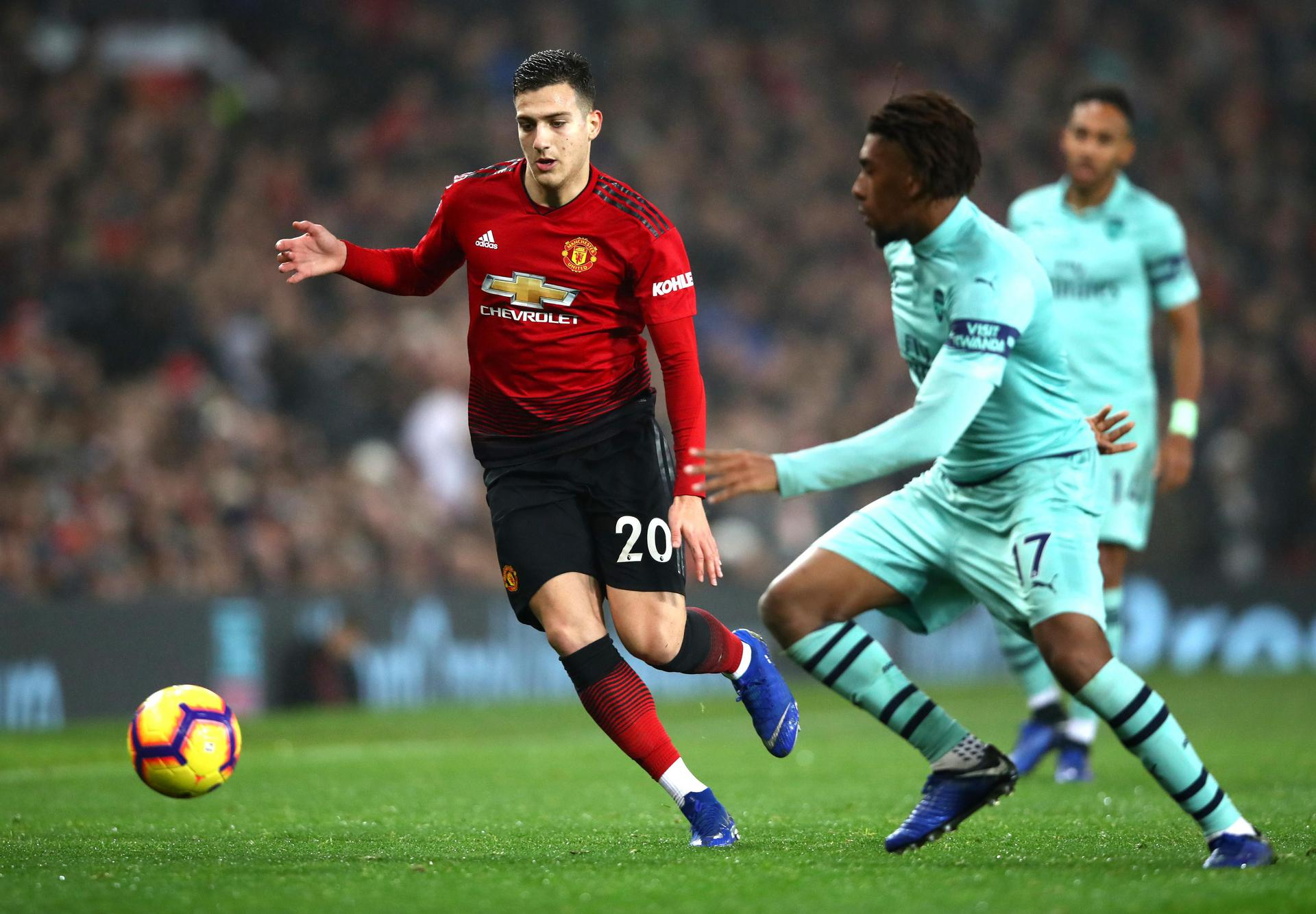 Diogo Dalot in action against Arsenal on his first Premier League start