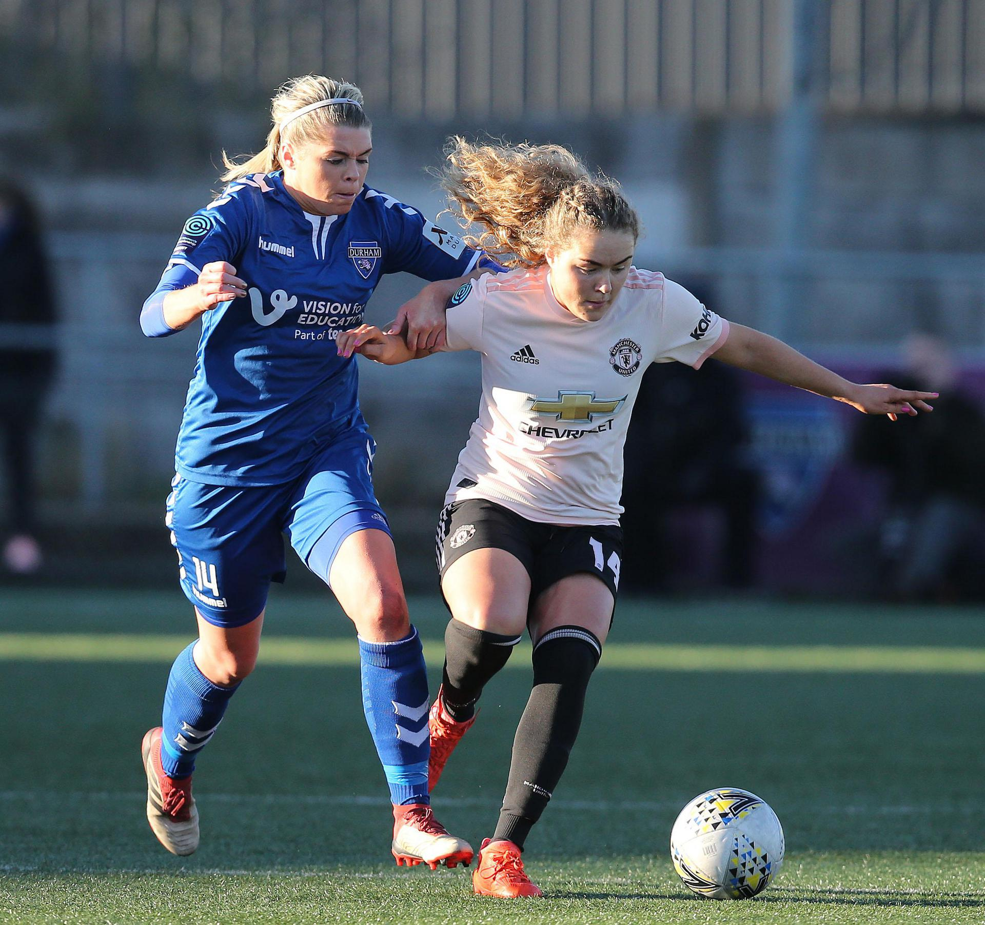 Charlie Devlin battles for the ball with Durham defender Becky Salicki