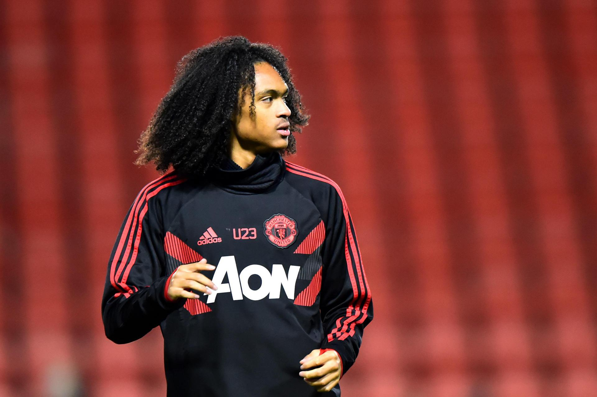 Tahith Chong in his training top.