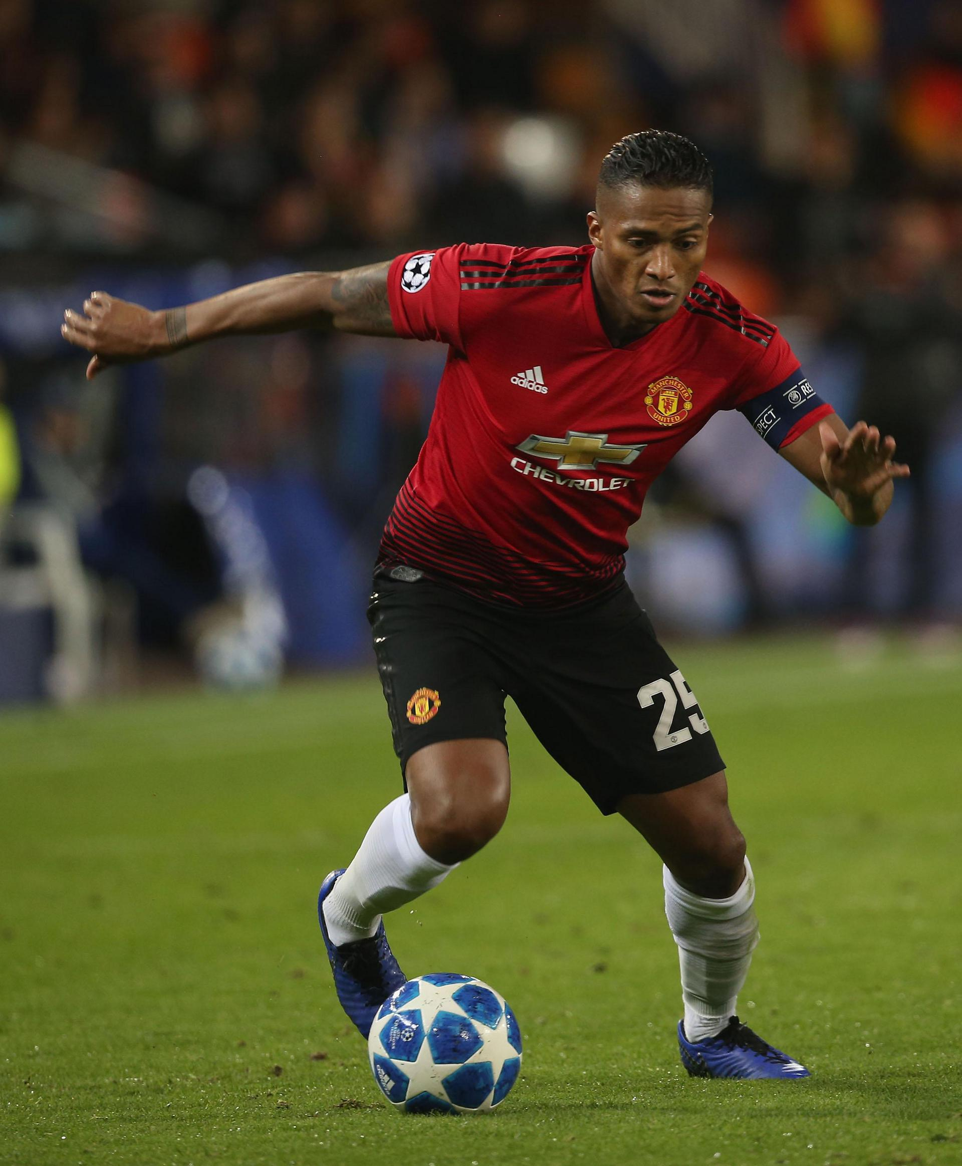 Antonio Valencia in Champions League action for Manchester United, wearing the captain's armband
