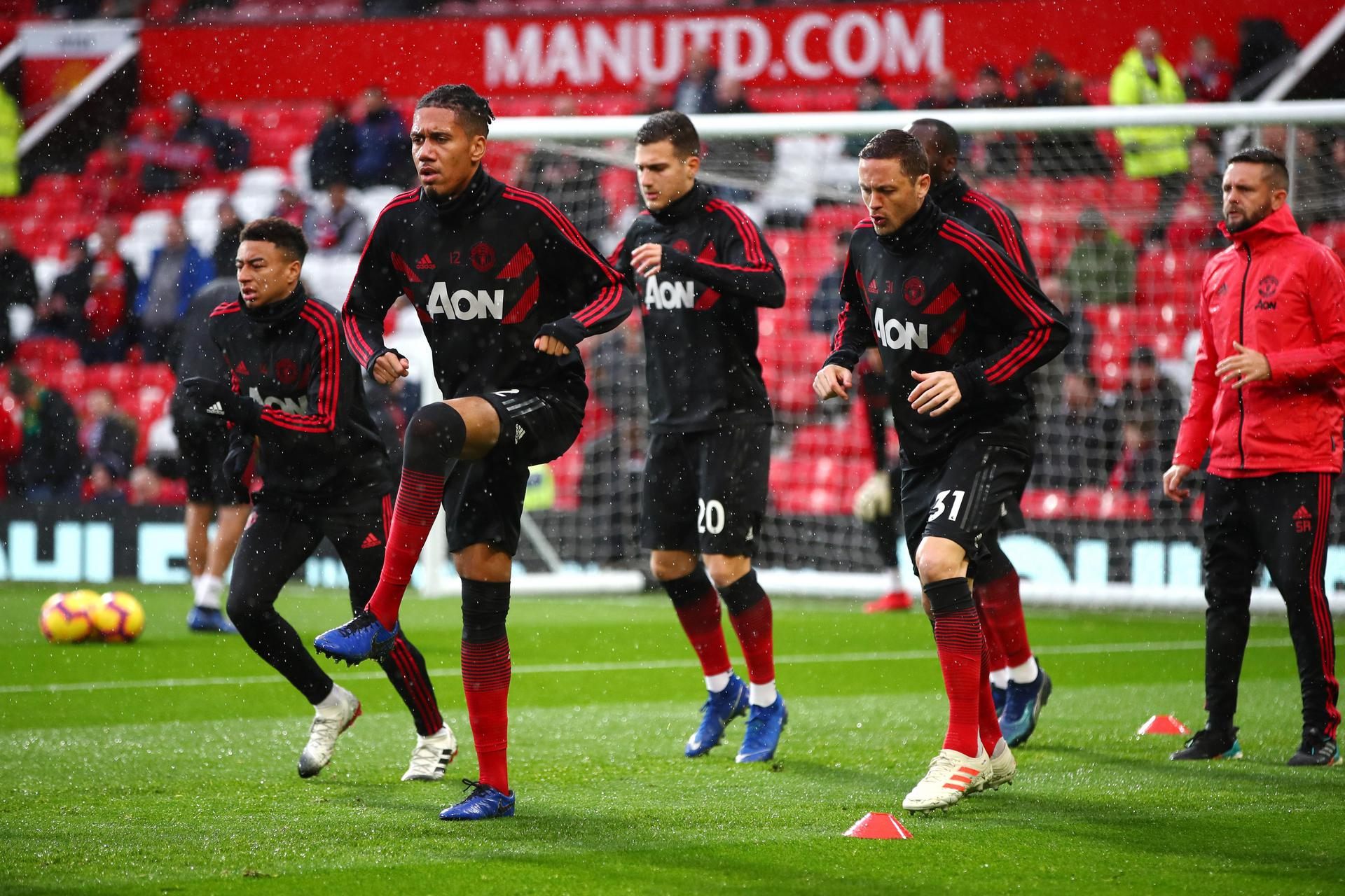 Lingard, Smalling, Dalot and Matic warm up before a match at Old Trafford
