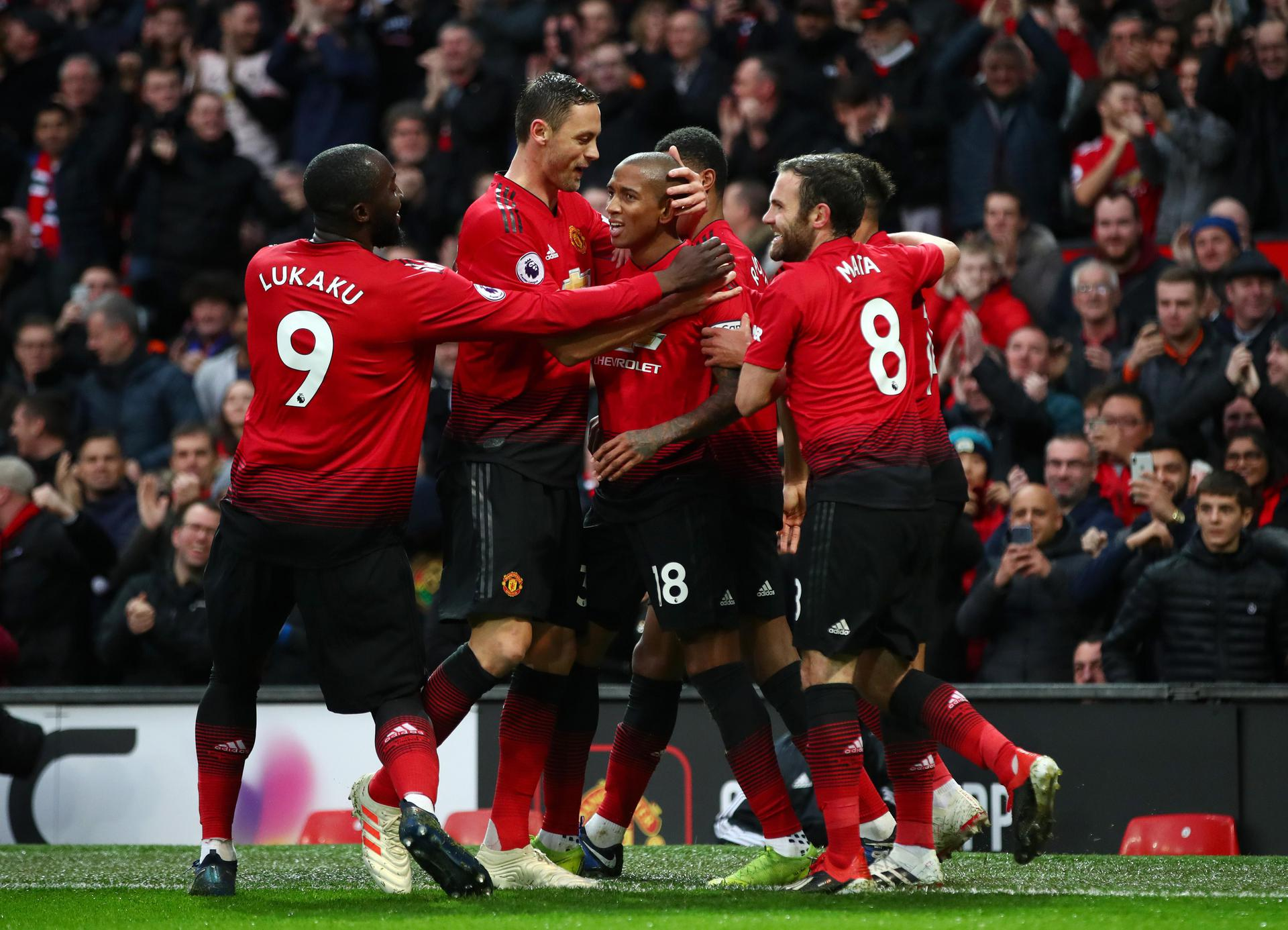 United players celebrate a goal at Old Trafford.