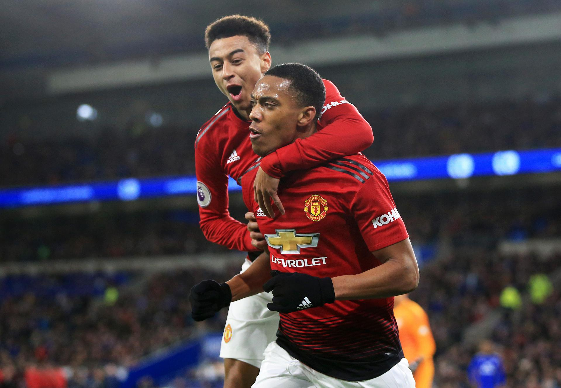 Jesse Lingard and Anthony Martial celebrating a goal at Cardiff City.