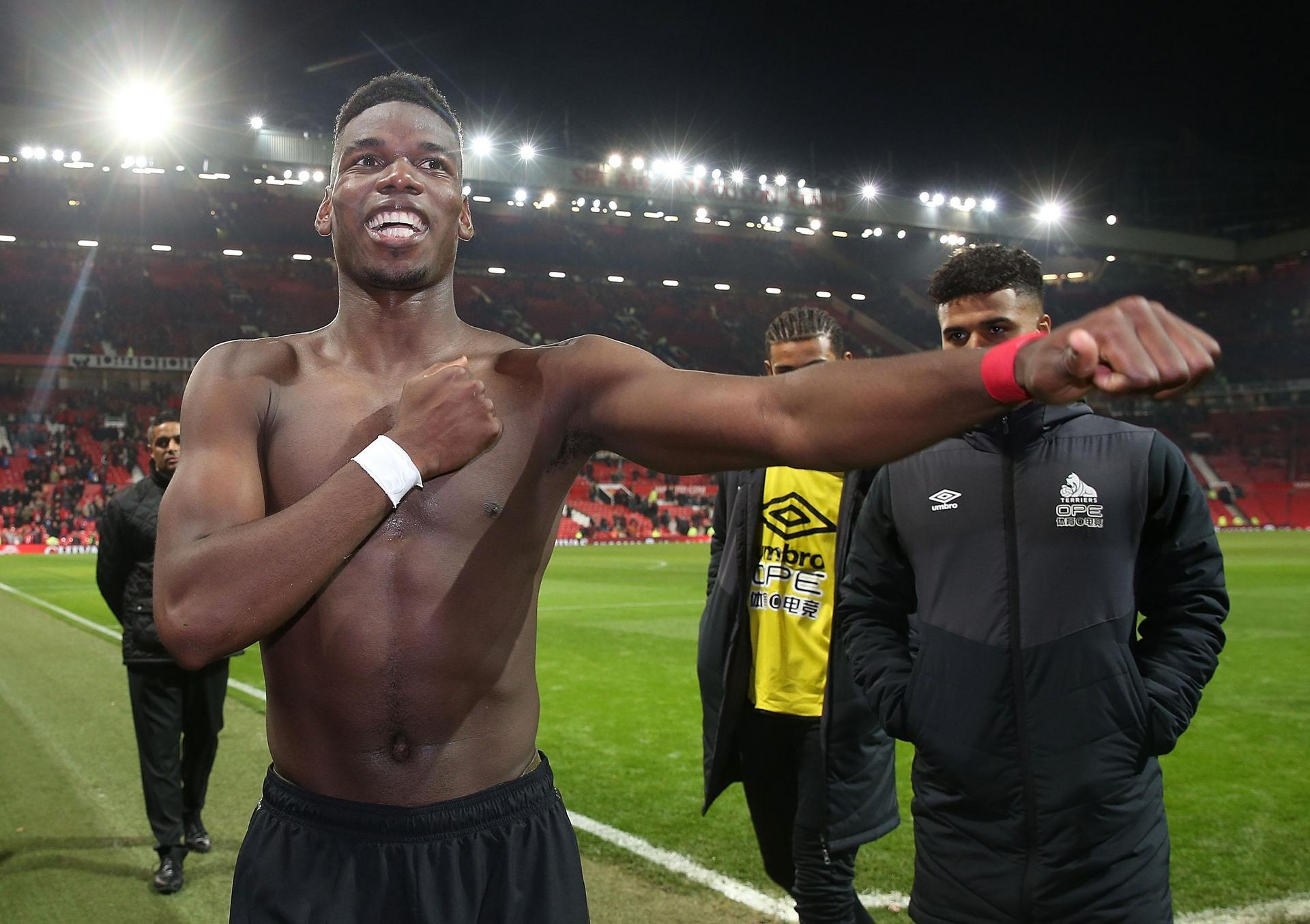 Paul Pogba bares his chest after the final whistle.