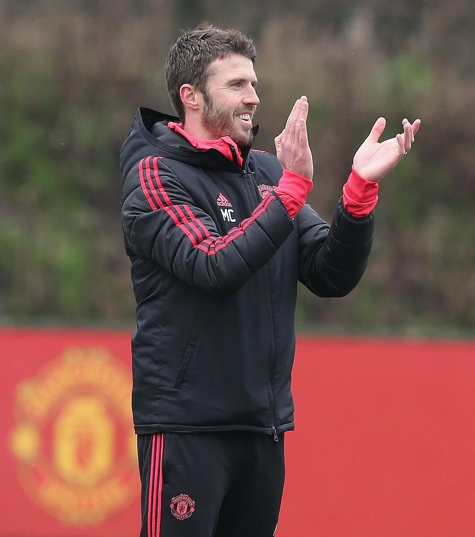 Michael Carrick claps during a training session.