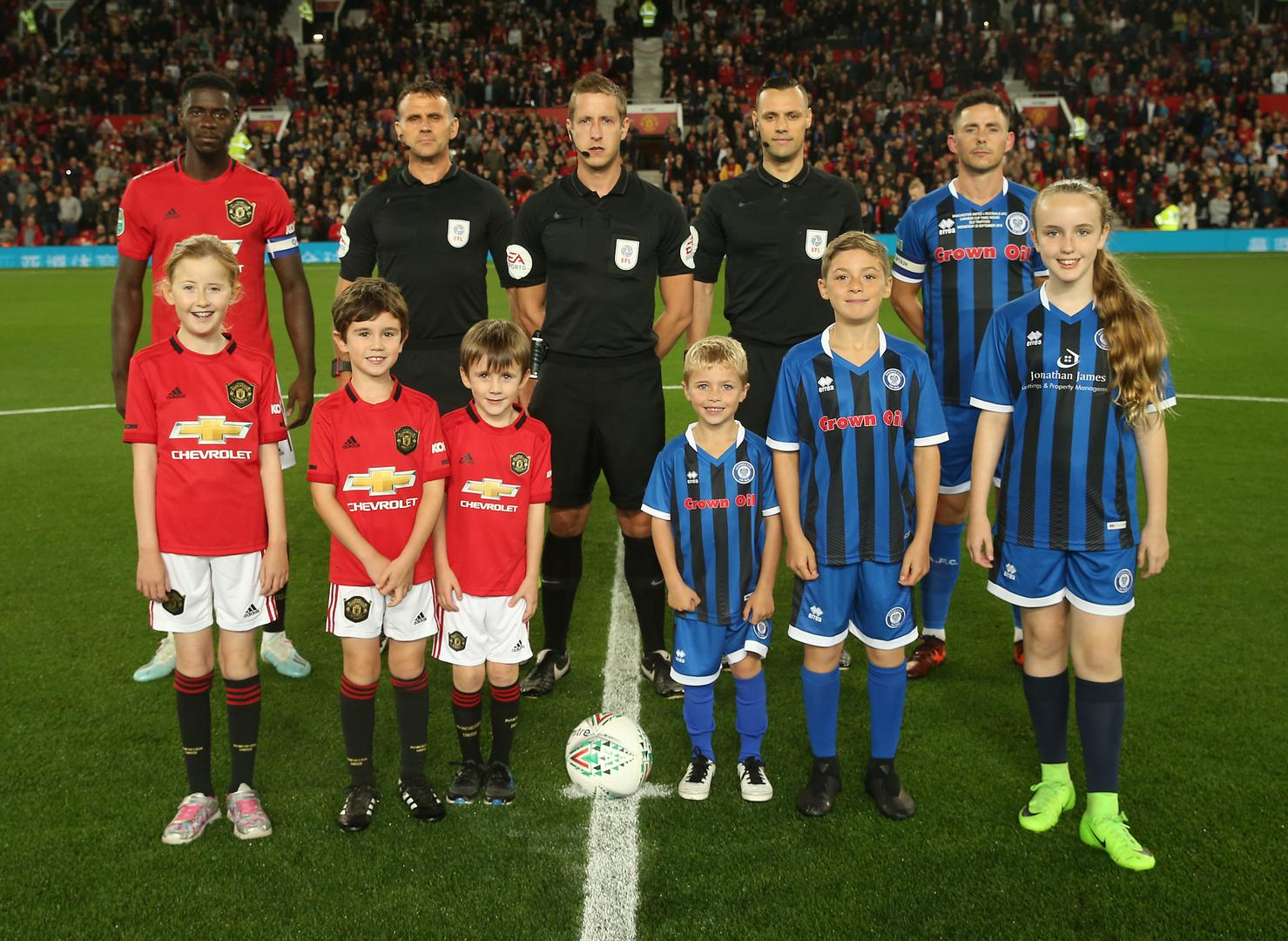 Manchester United and Rochdale line up before a game.