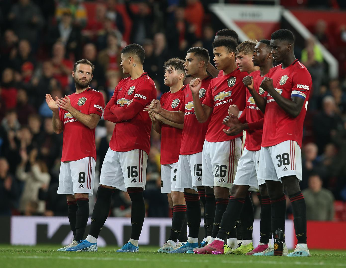 United players during the shoot-out.