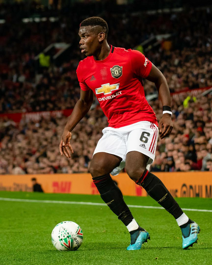 Paul Pogba playing for Manchester United against Rochdale.
