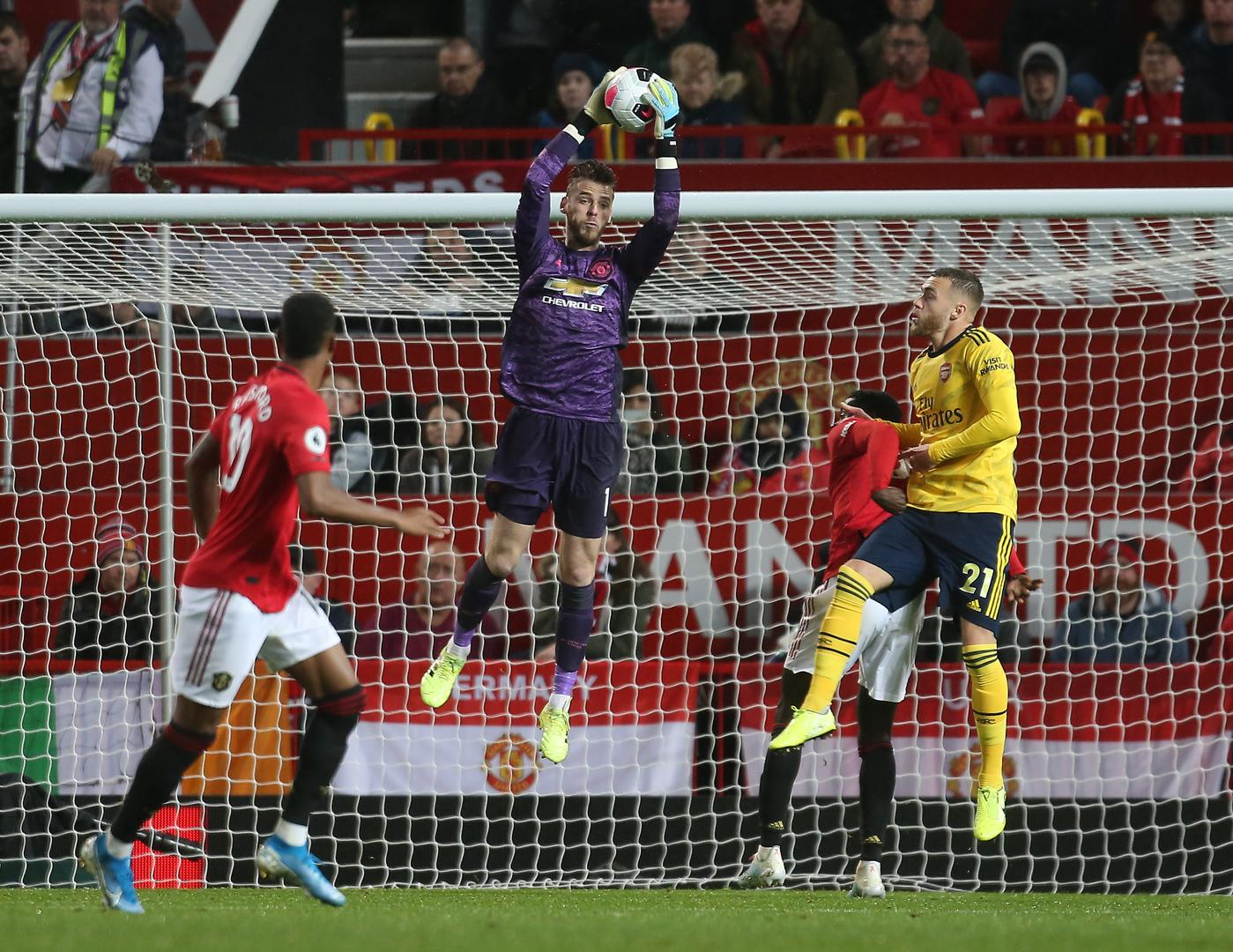 David De Gea rises to catch the ball.,