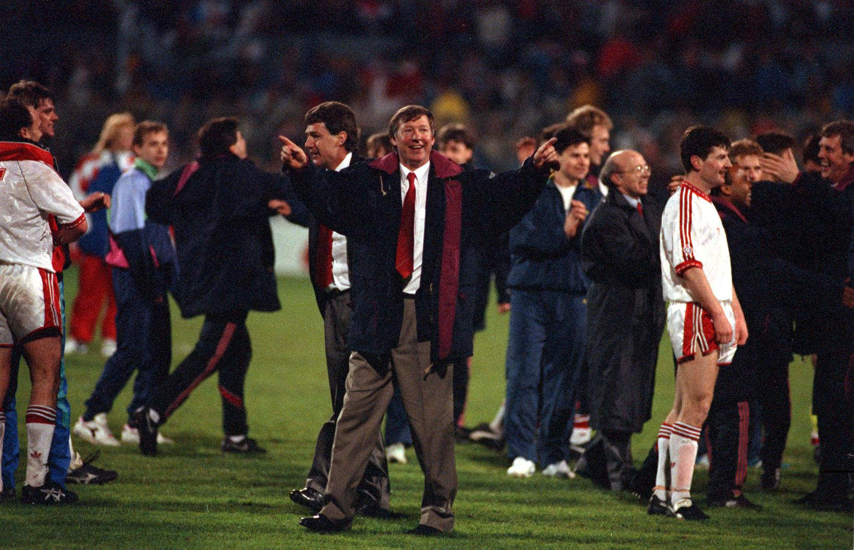 Alex Ferguson celebrates Manchester United's Cup Winners' Cup triumph over Barcelona in 1991.