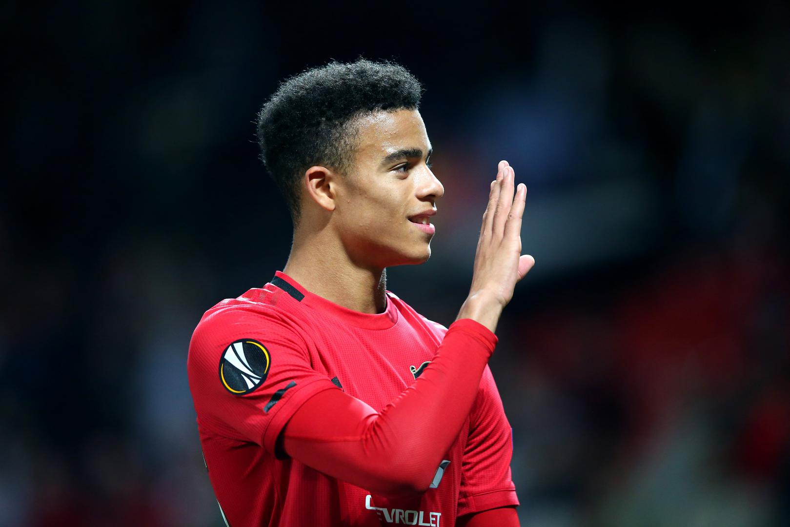 Mason Greenwood waves to the crowd.