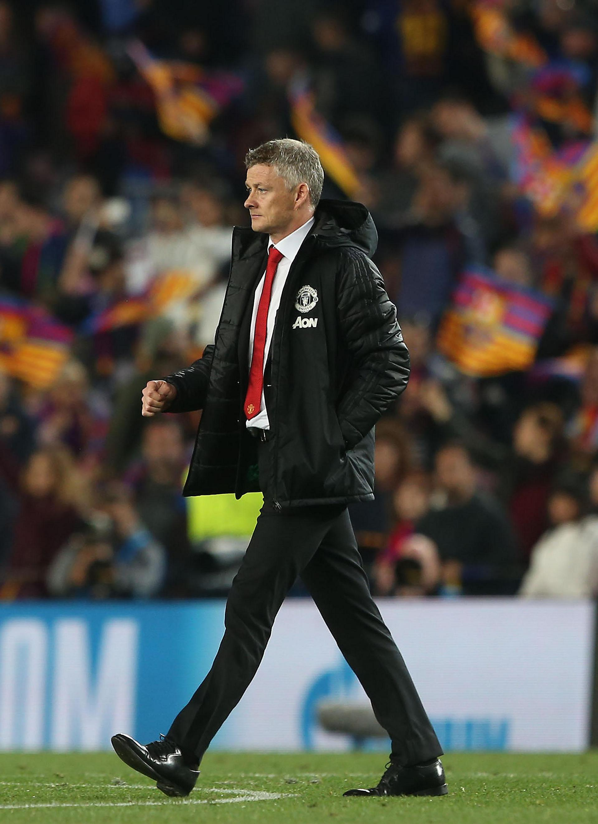 Ole Gunnar Solskjaer walks off the pitch at full time.