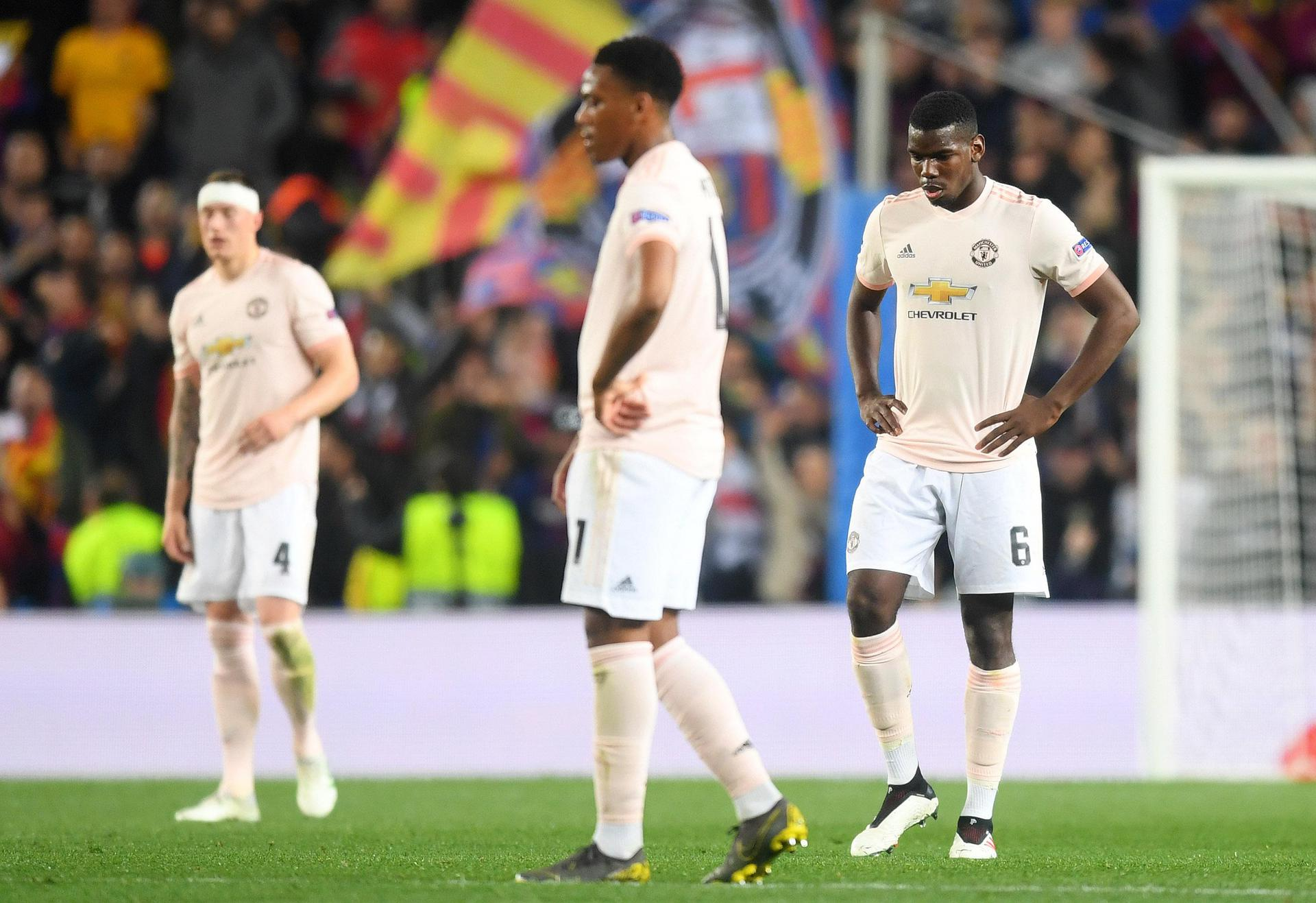 Phil Jones, Anthony Martial and Paul Pogba look downbeat during the defeat to Barcelona,