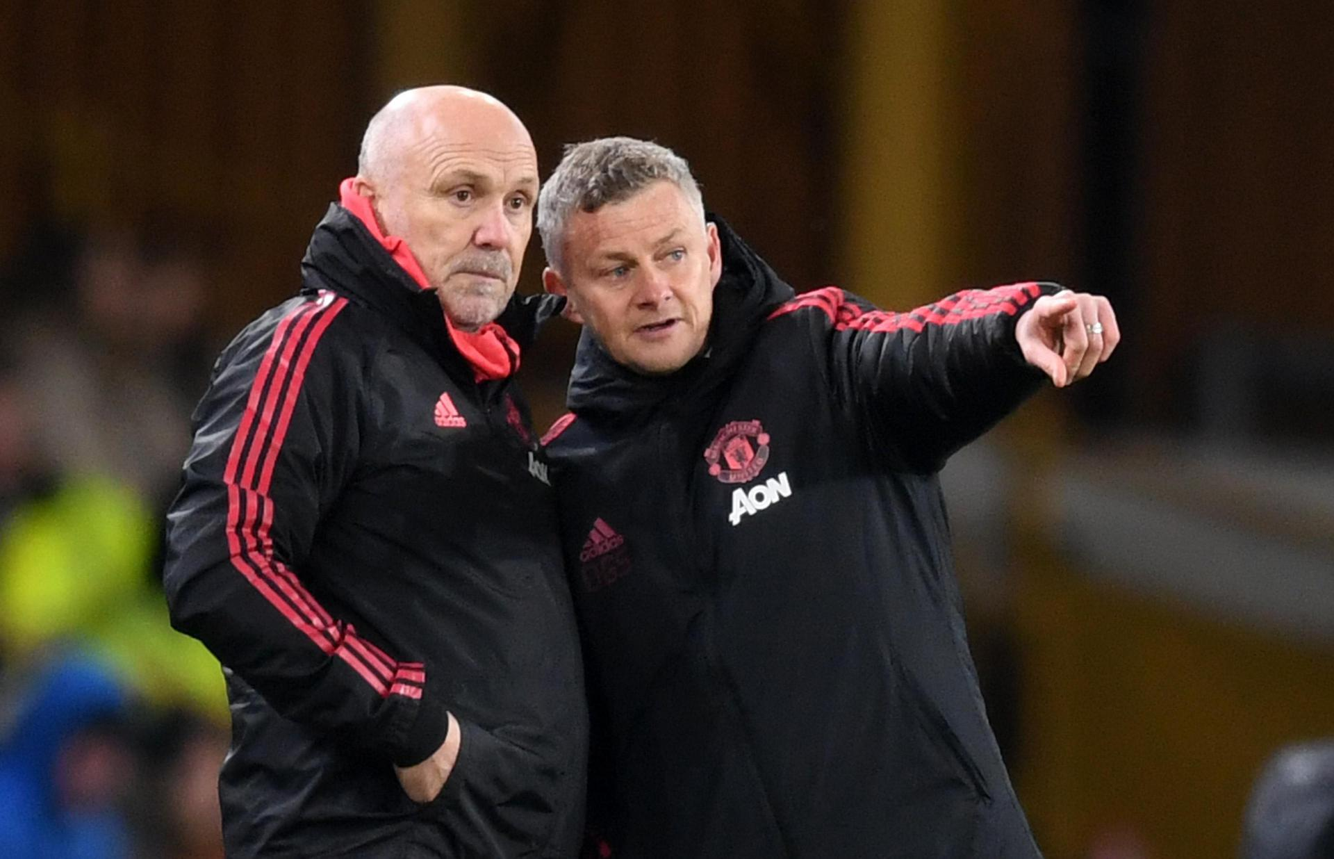 Ole Gunnar Solskjaer and Mike Phelan.