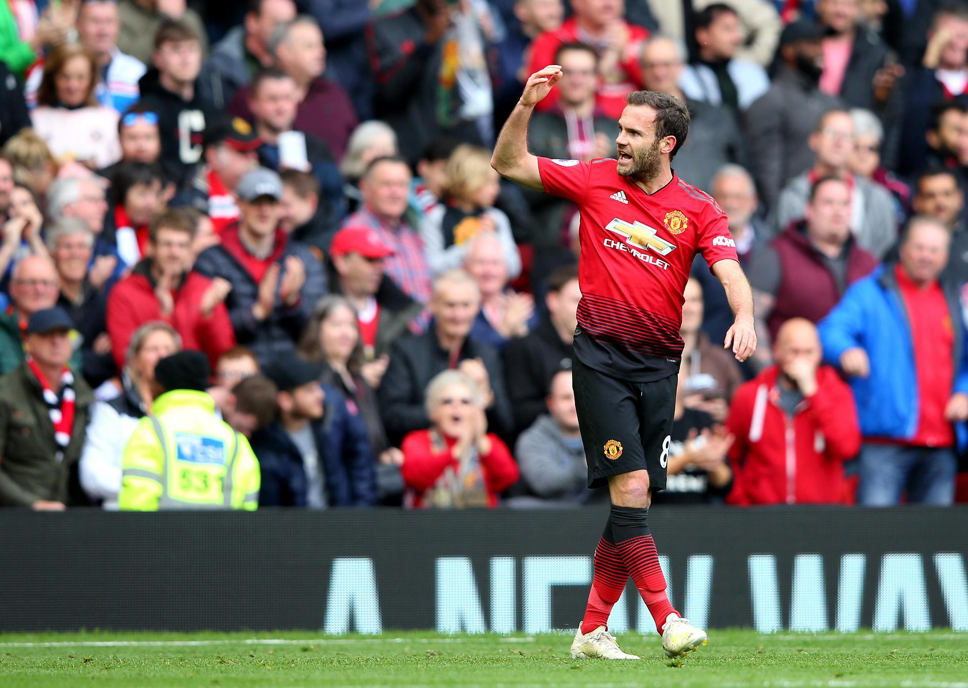 Juan Mata celebrates his goal against Chelsea.