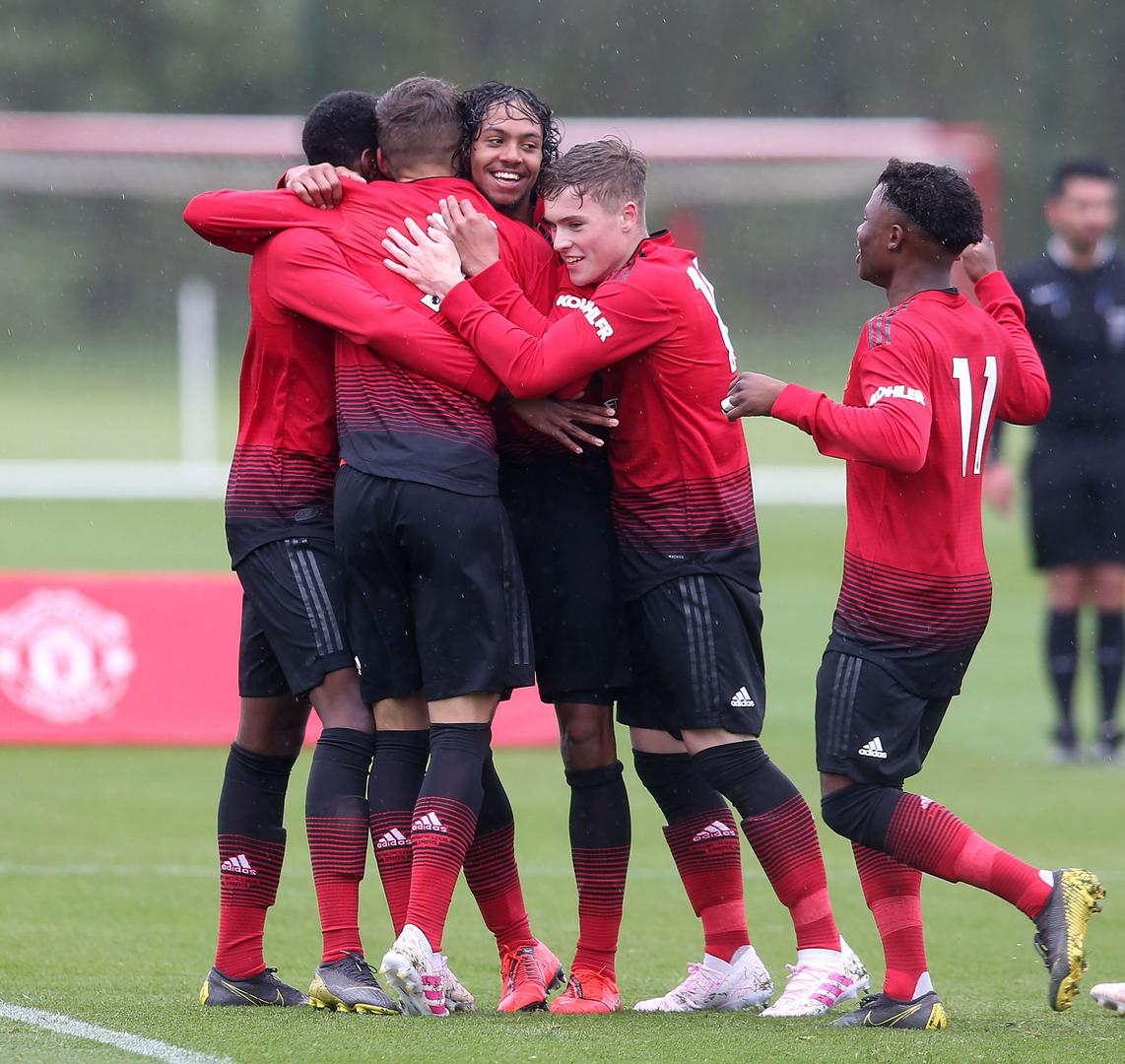 United's Under-18s celebrate a goal against Everton.