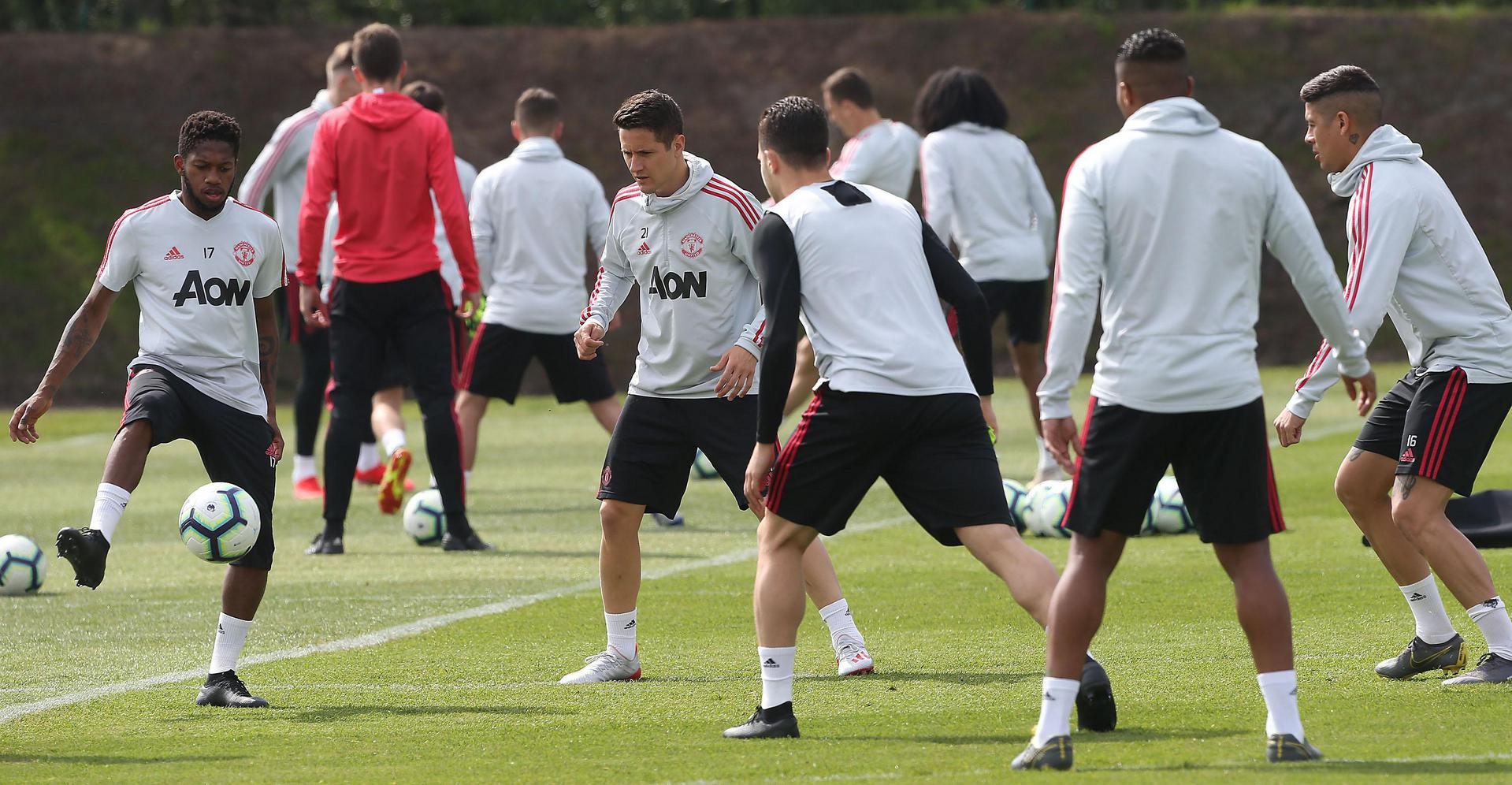 Fred, Ander Herrera and Marcos Rojo take part in a first-team practice session at the Aon Training Complex