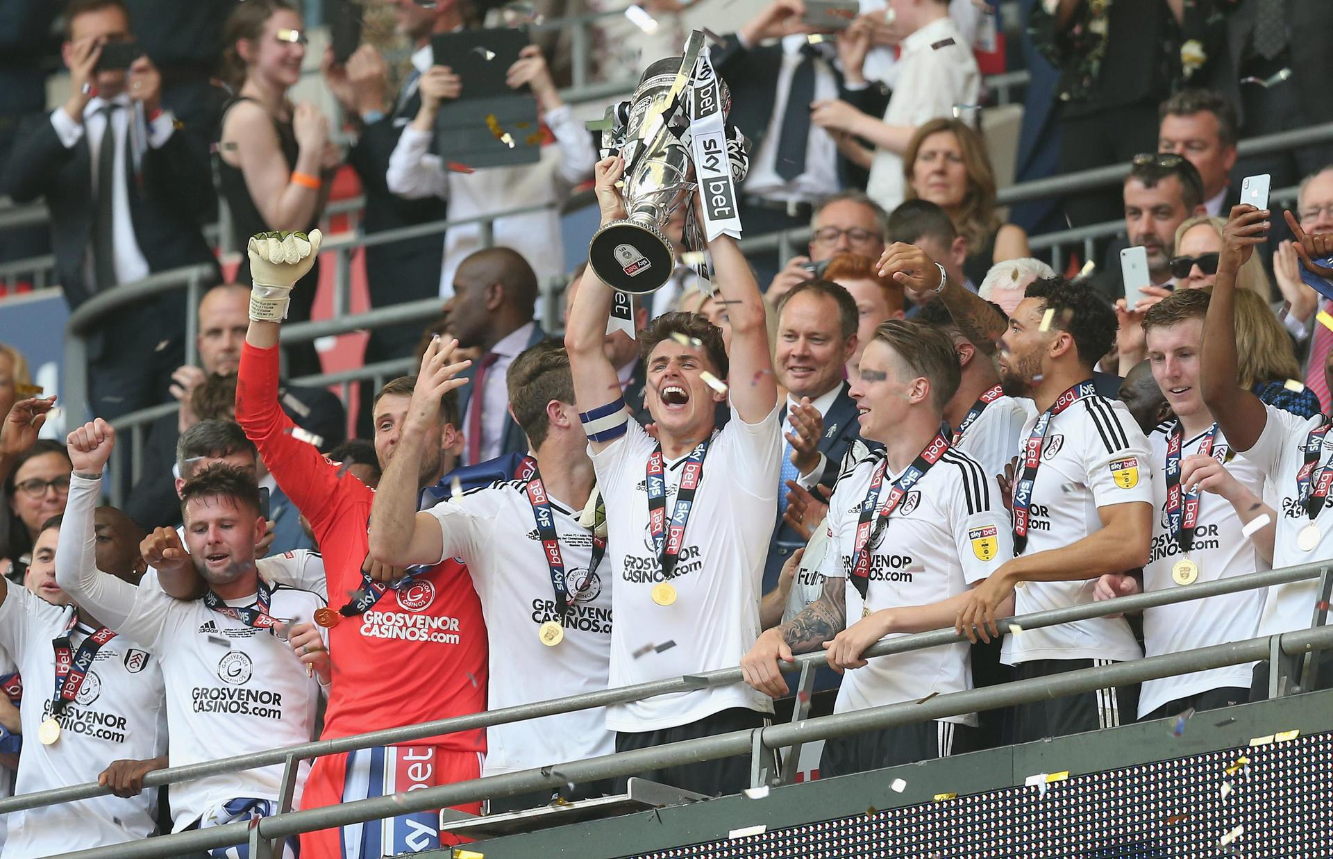 Fulham lift the Championship play-off trophy.