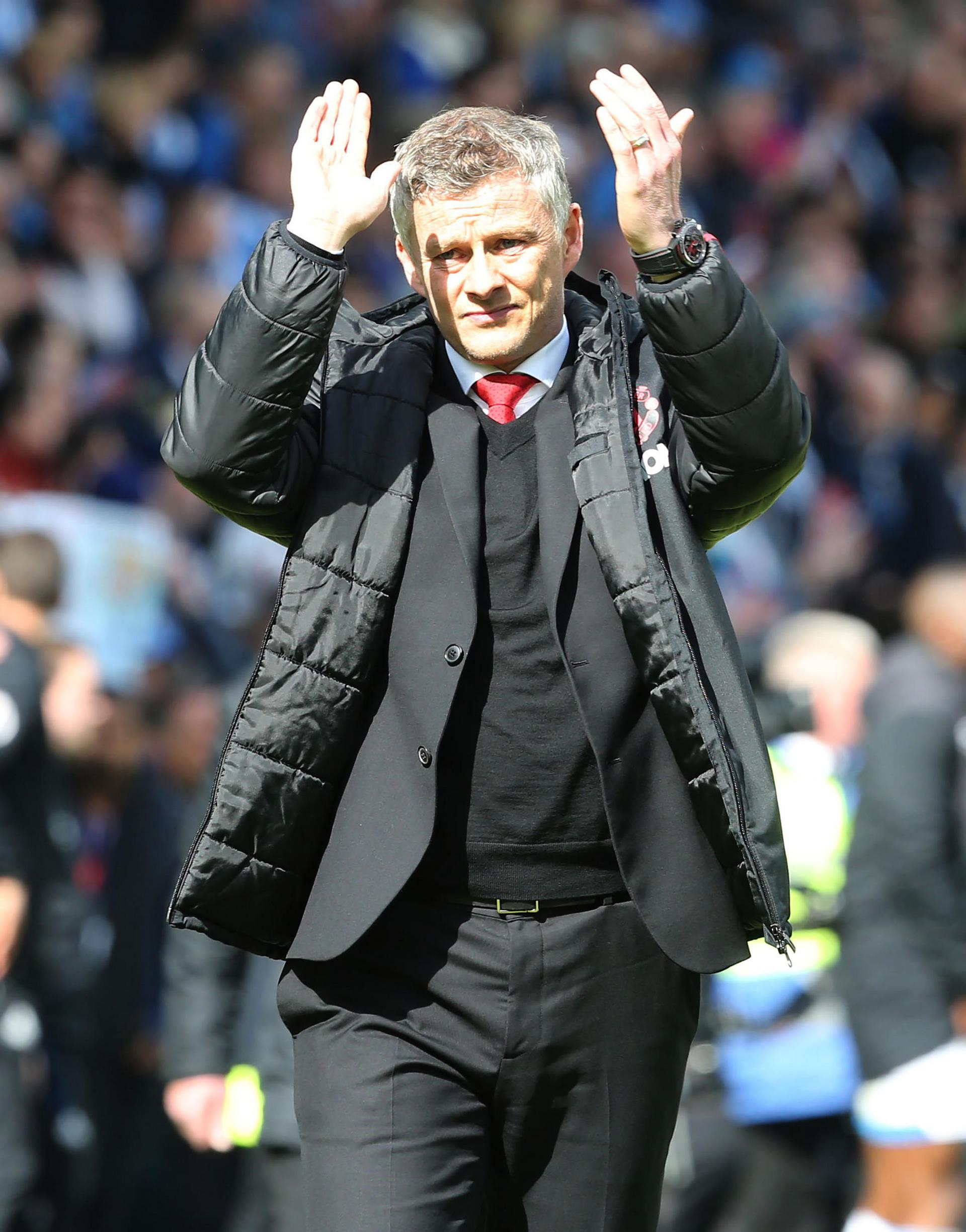 Ole Gunnar Solskjaer applauds the United fans at Huddersfield,