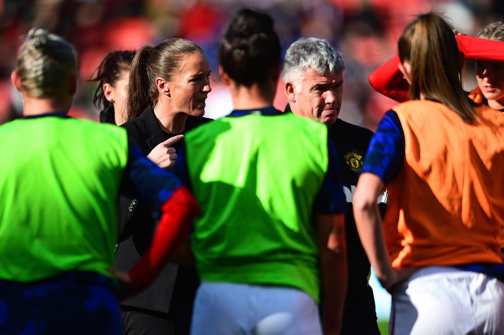 Casey Stoney gives a team talk before Manchester United Women's 2-0 win over Manchester City.