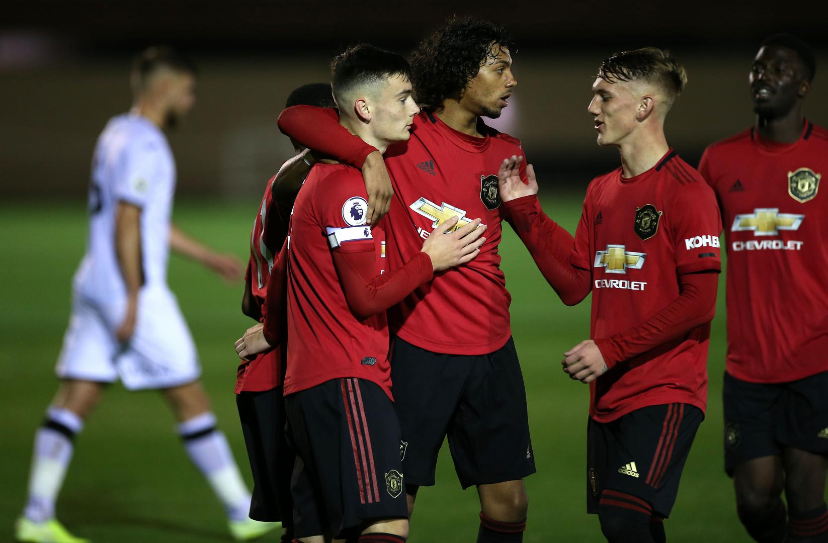 Dylan Levitt celebrates his goal against Swansea City with his Manchester United U23s team-mates