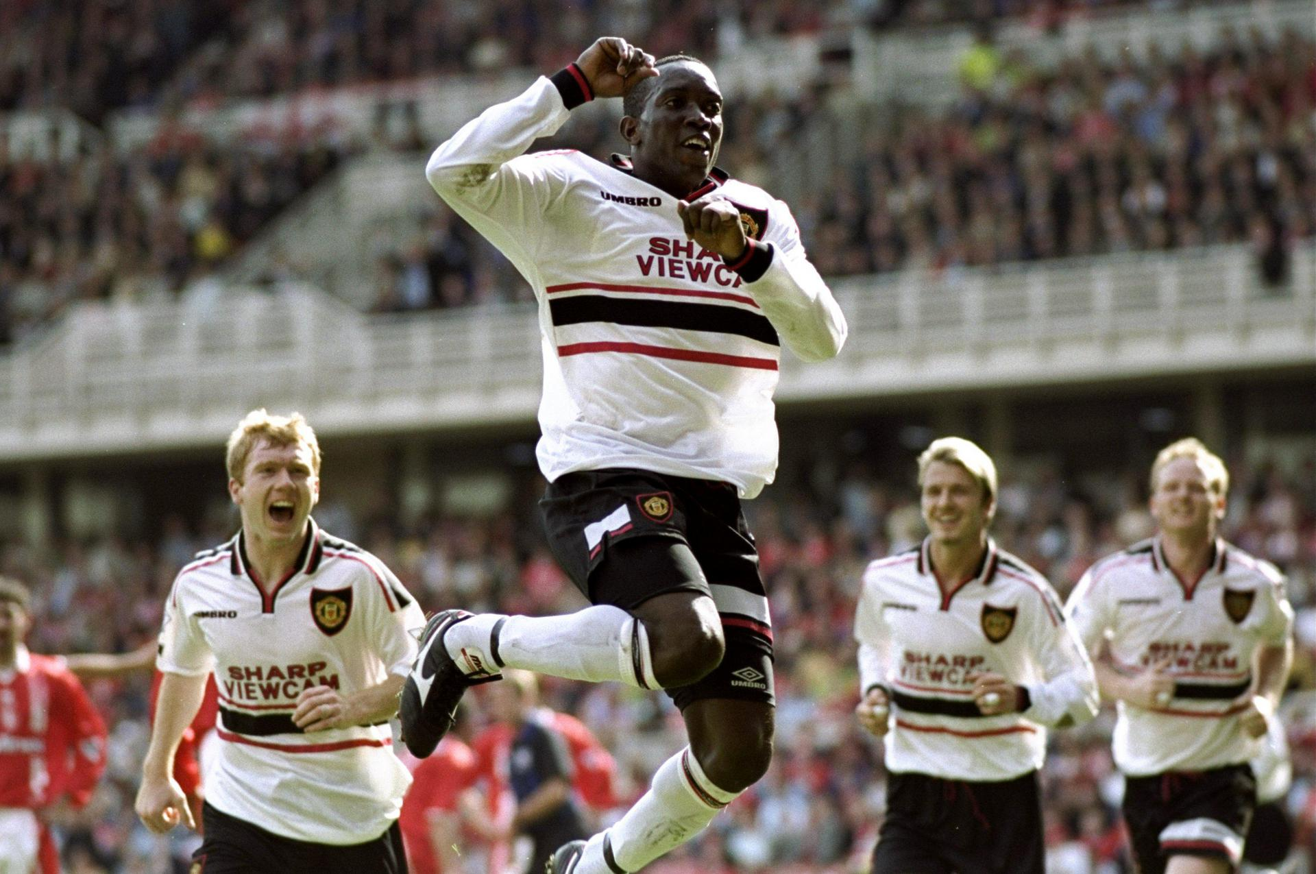 Dwight Yorke celebrates scoring for Man Utd.