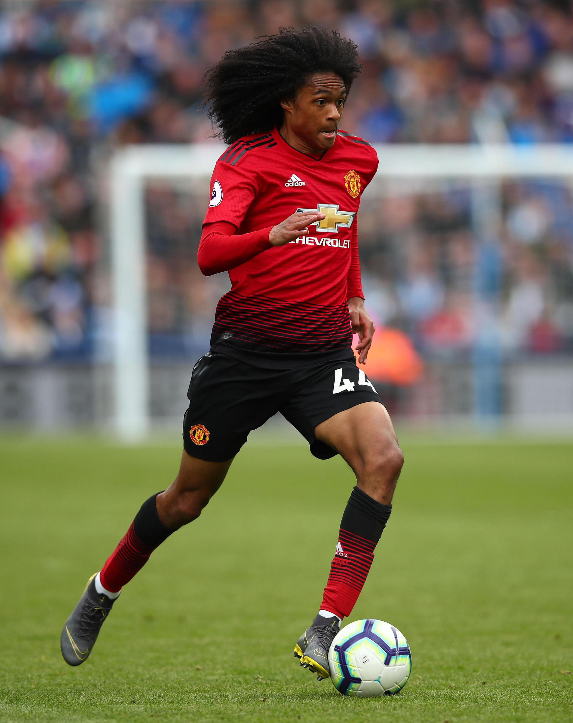 Tahith Chong playing for United.