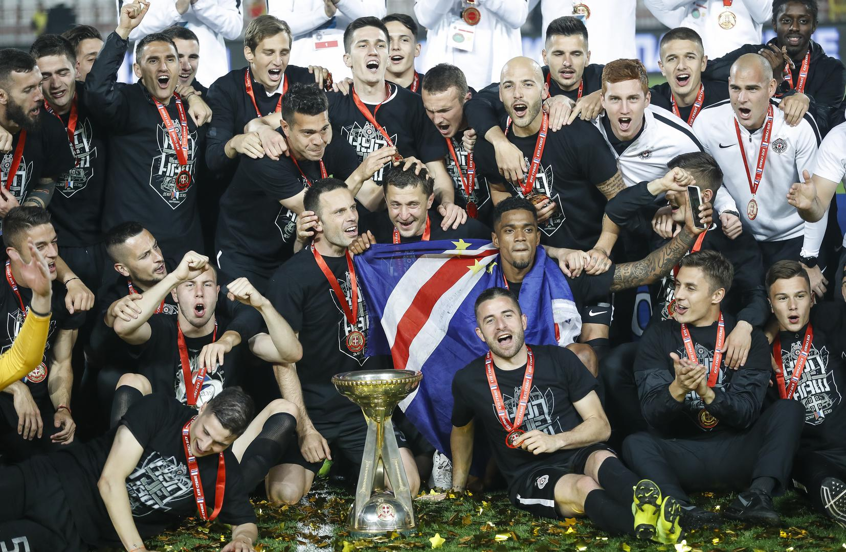 Partizan Belgrade players celebrate after winning the 2019 Serbian Cup final,