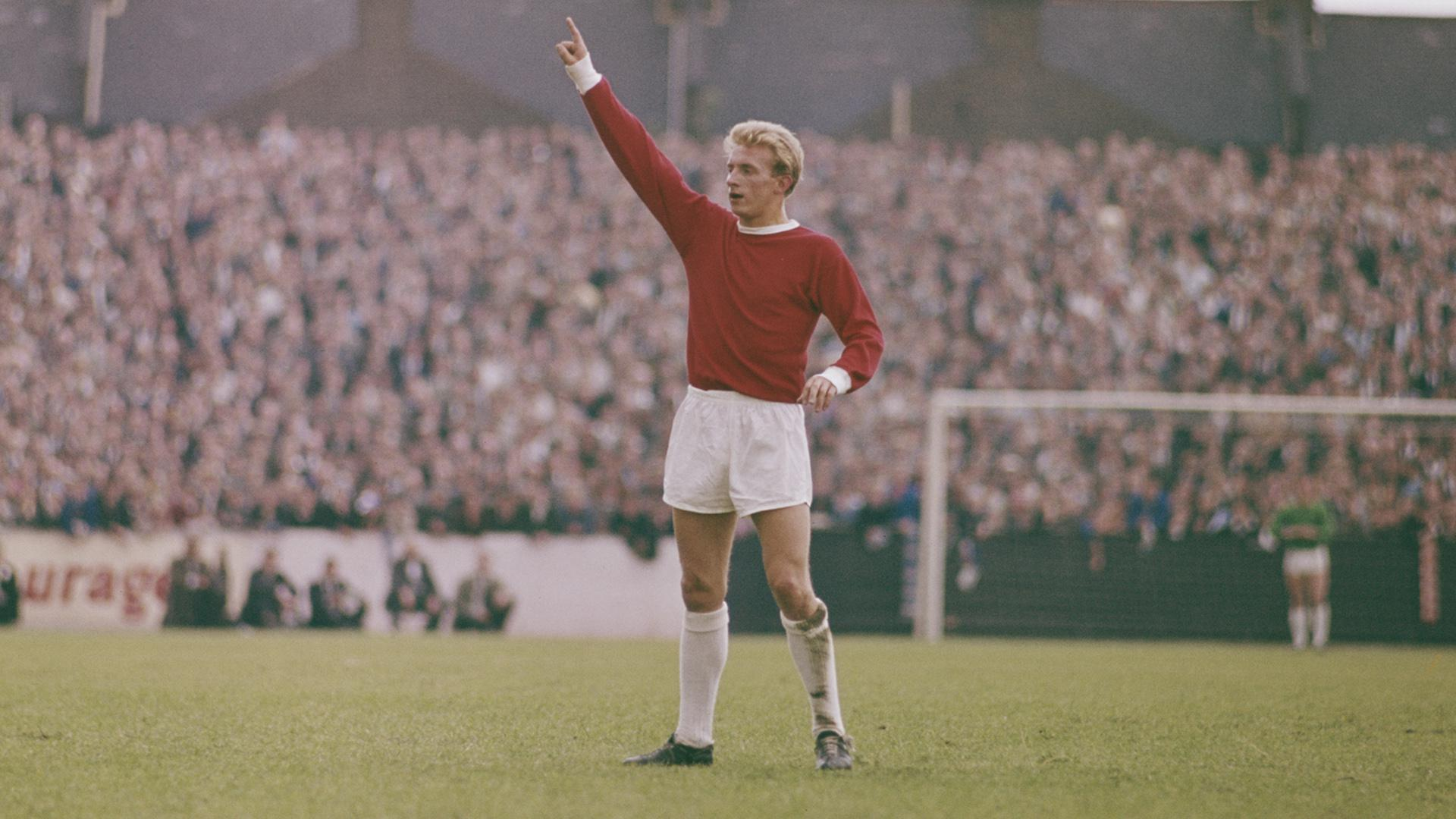 Denis Law playing for Manchester United.