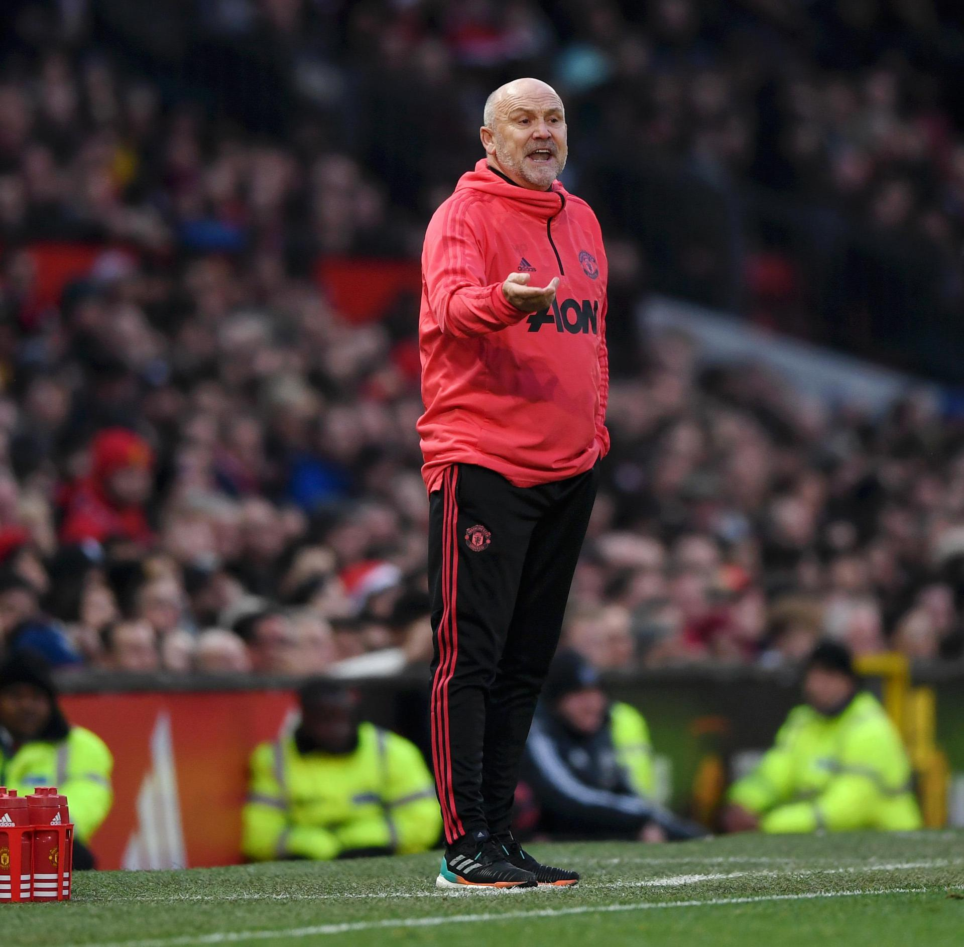 Mike Phelan on the touchline at Old Trafford.,